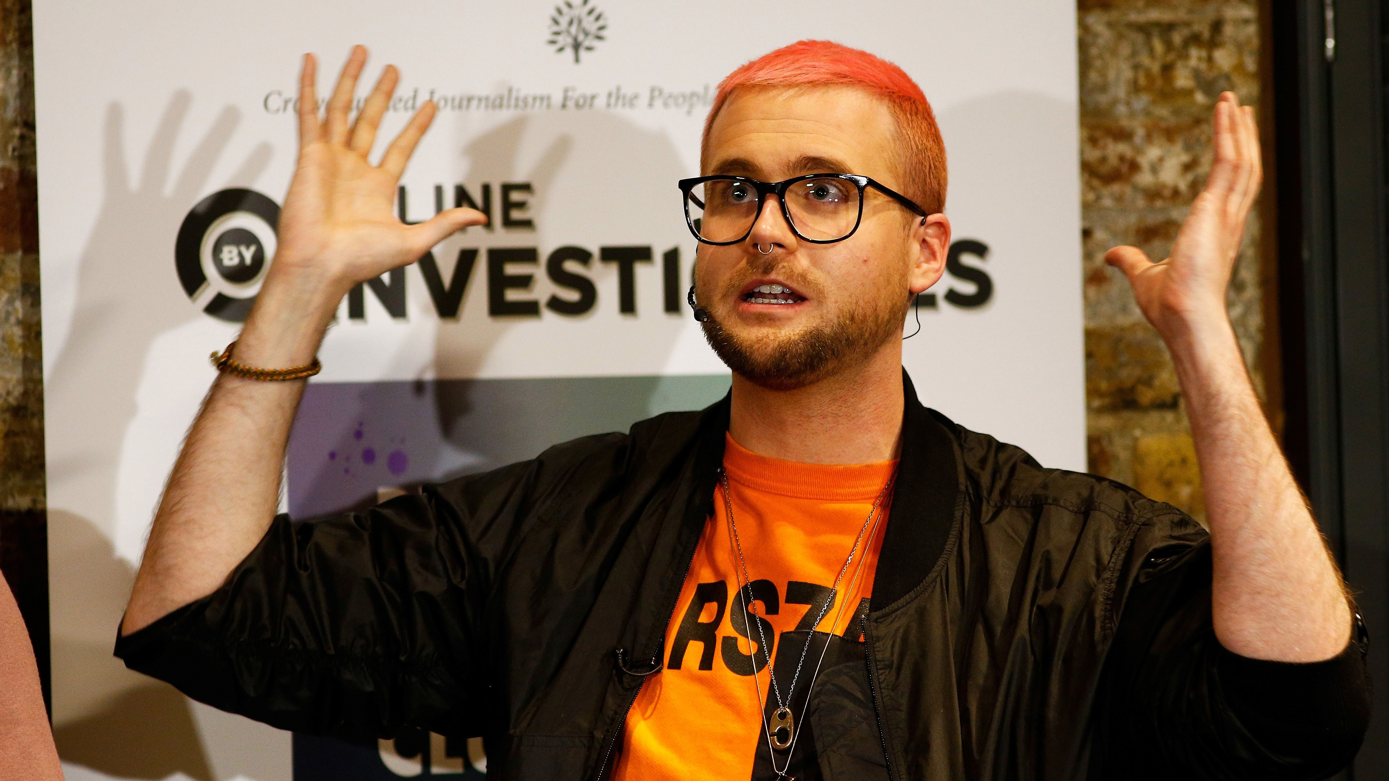 Christopher Wylie, a whistleblower who formerly worked with Cambridge Analytica, speaks next to Shahmir Sanni (not in picture), a former volunteer at Vote Leave group, at the Frontline Club in London, Britain, March 26, 2018.