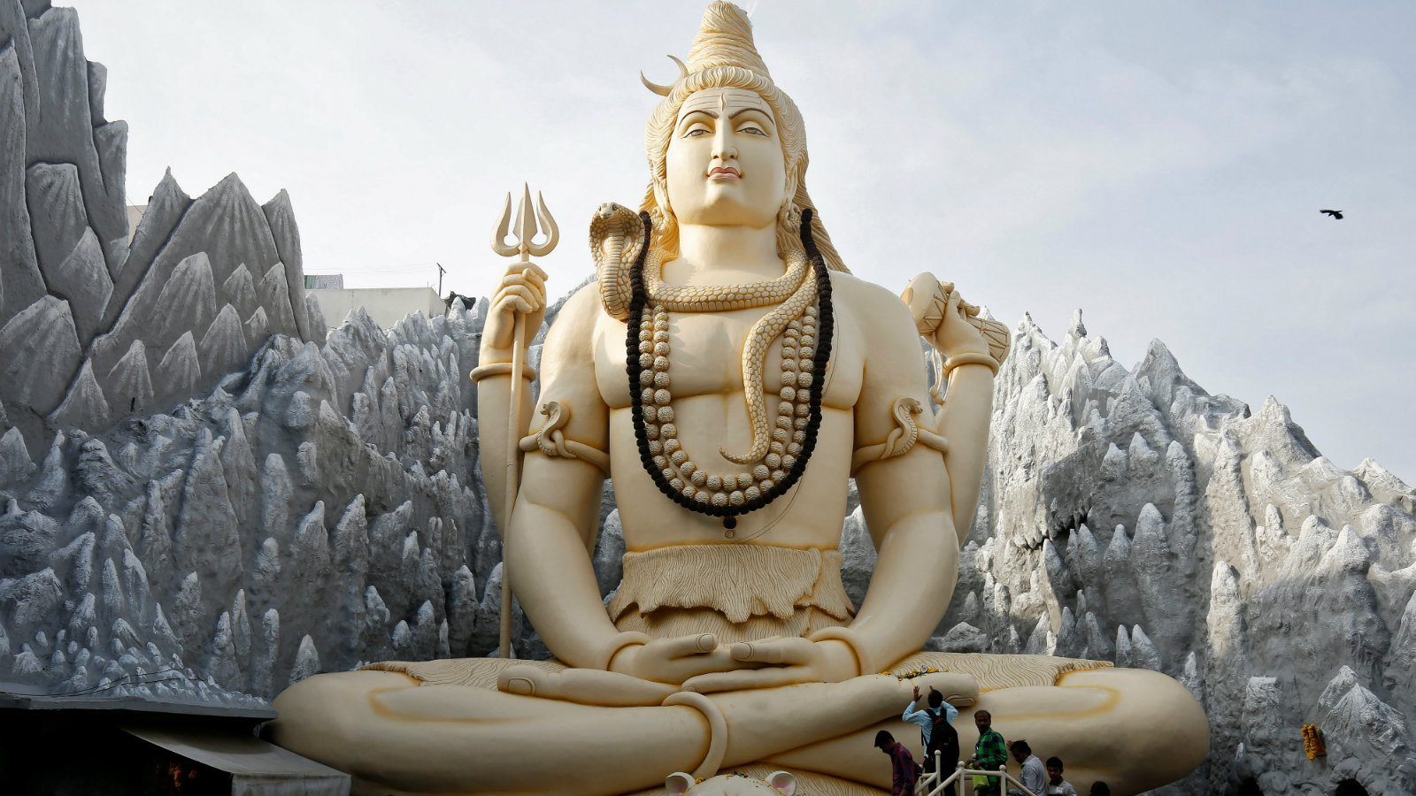 Devotees offer prayers and perform rituals before a statue of Lord Shiva in Bengaluru.
