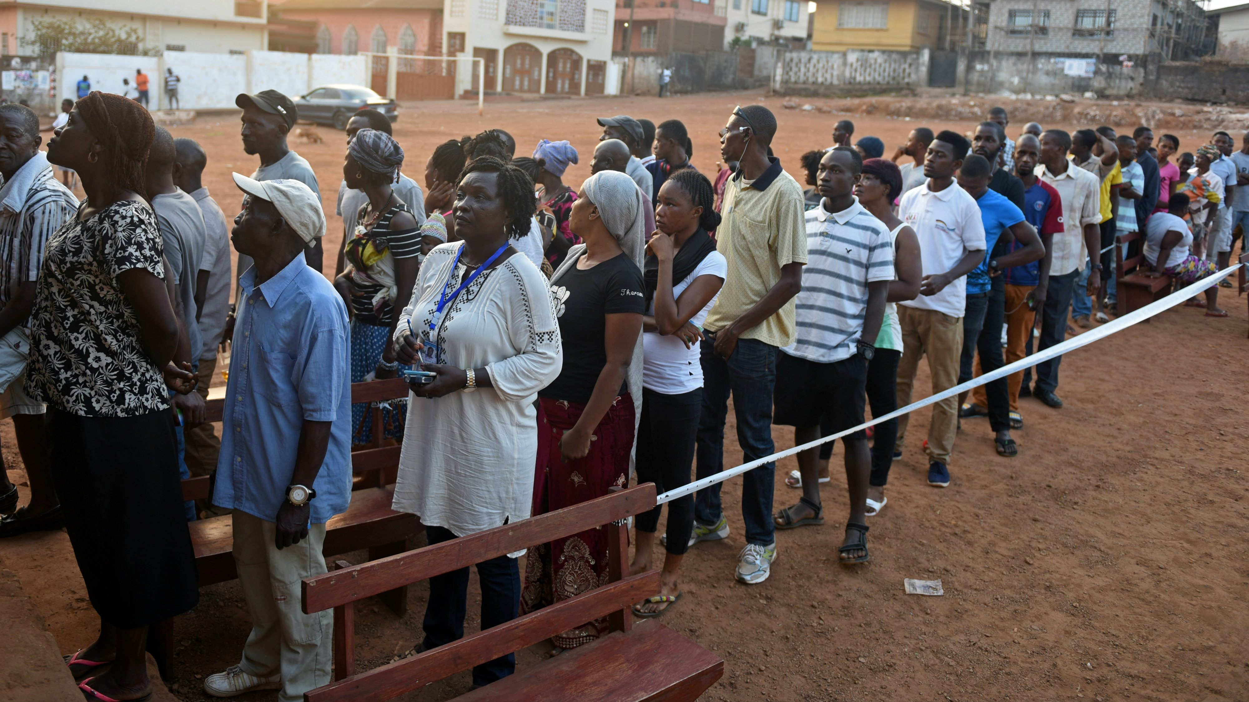People Queue To Cast Their Vote At A Polling Station During Sierra Leones Presidential Election In