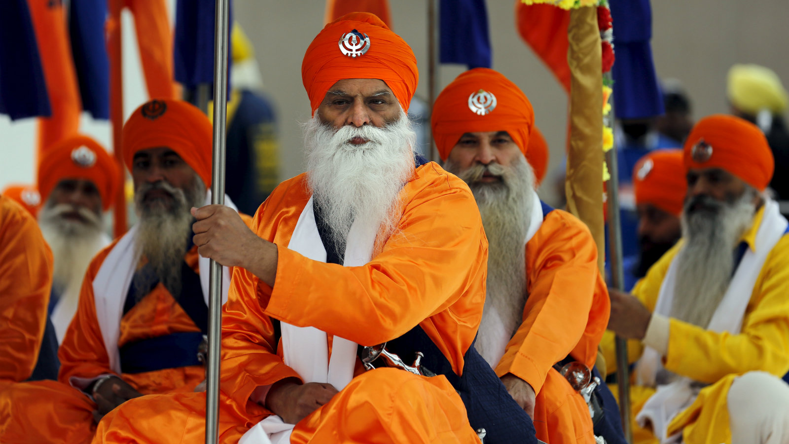 Sikh marchers sit after a Khalsa Day parade in Toronto, Canada, in 2016.