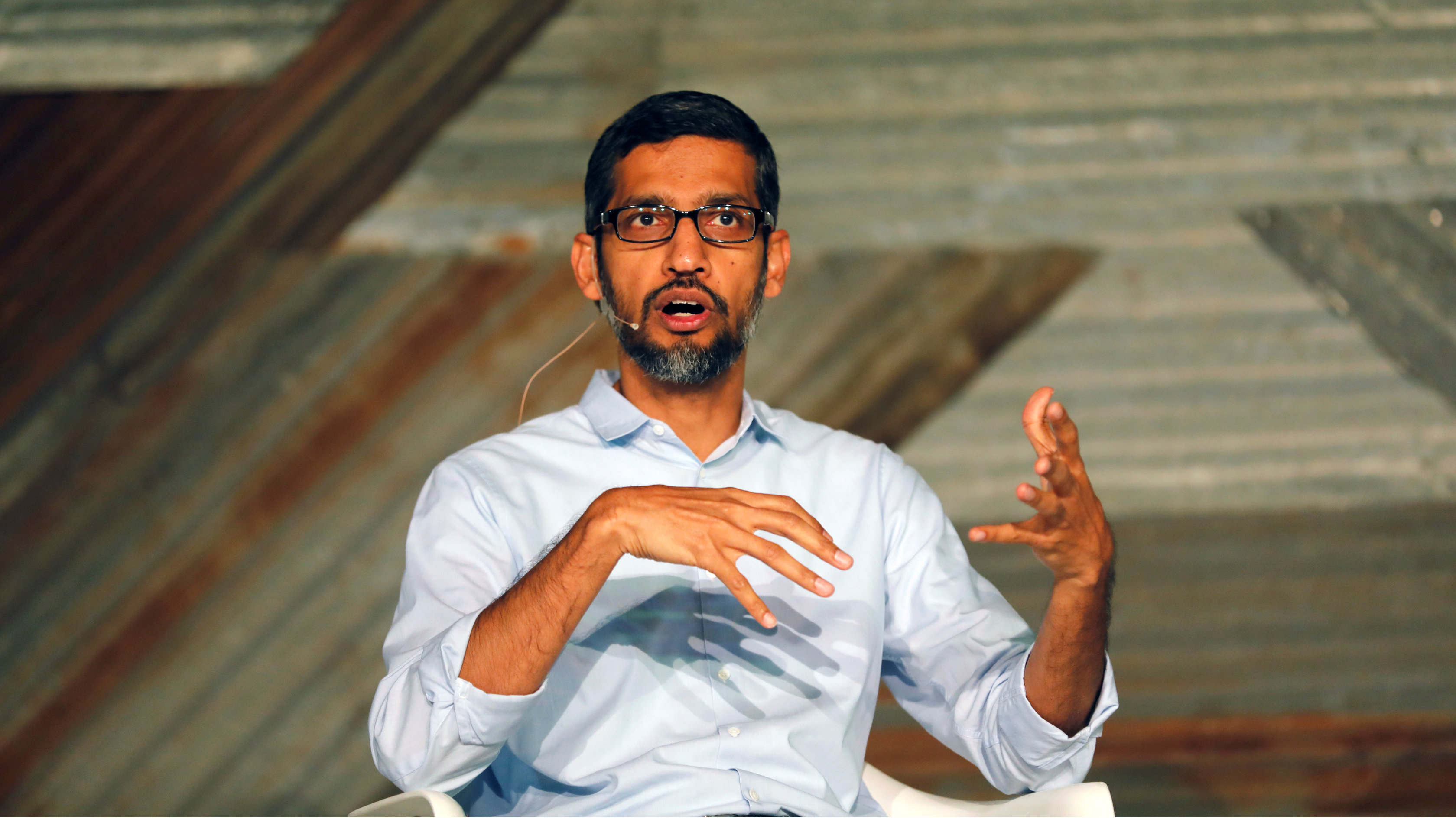 Google's CEO Sundar Pichai speaks on stage during a conference tagged 'Google for Nigeria' in Nigeria's commercial capital Lagos, July 27, 2017.