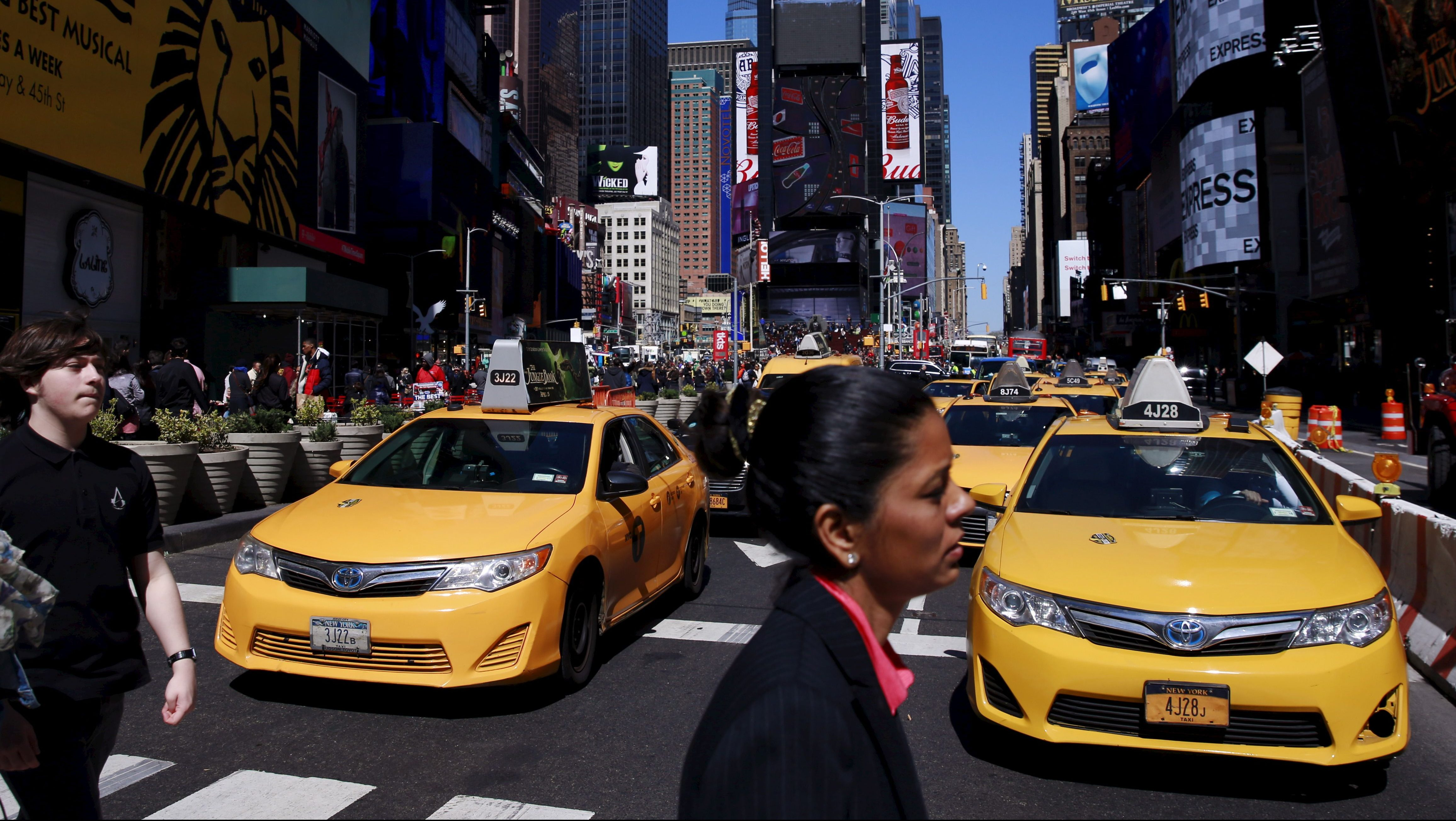 New York City taxi cabs drive through Times Square in New York March 29, 2016.  REUTERS/Lucas Jackson - GF10000364441