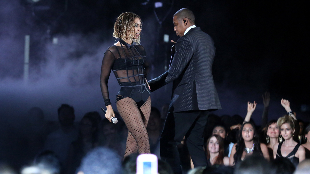 Beyonce, left, and Jay-Z perform on stage at the 56th annual GRAMMY Awards at Staples Center on Sunday, Jan. 26, 2014, in Los Angeles. (Photo by Matt Sayles/Invision/AP)