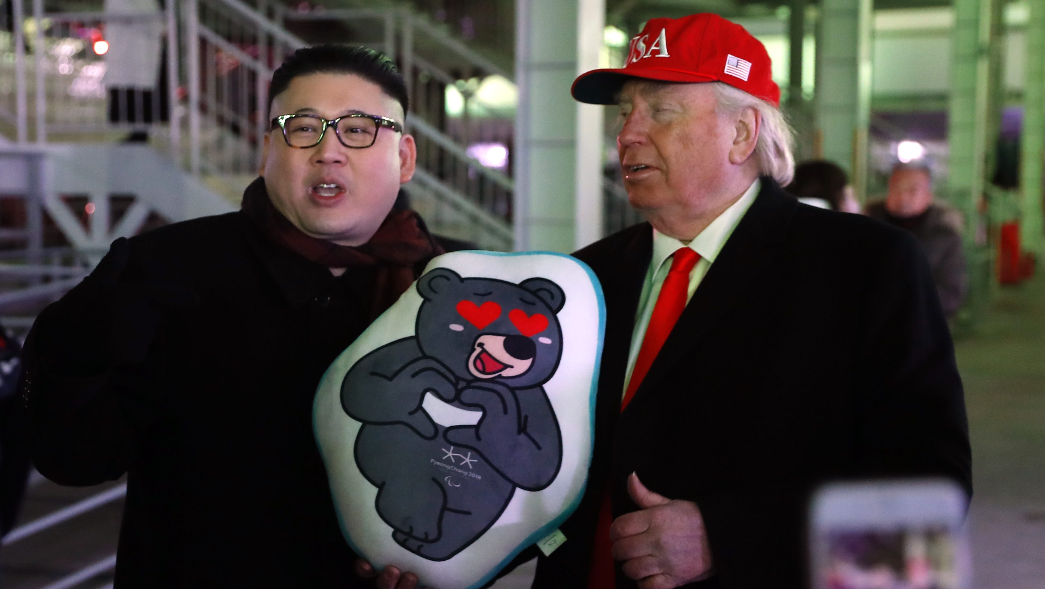 Pyeongchang 2018 Winter Olympics - Closing ceremony - Pyeongchang Olympic Stadium - Pyeongchang, South Korea - February 25, 2018 - Two men dressed as look-a-likes of U.S. President Donald Trump and North Korean leader Kim Jong Un pose.