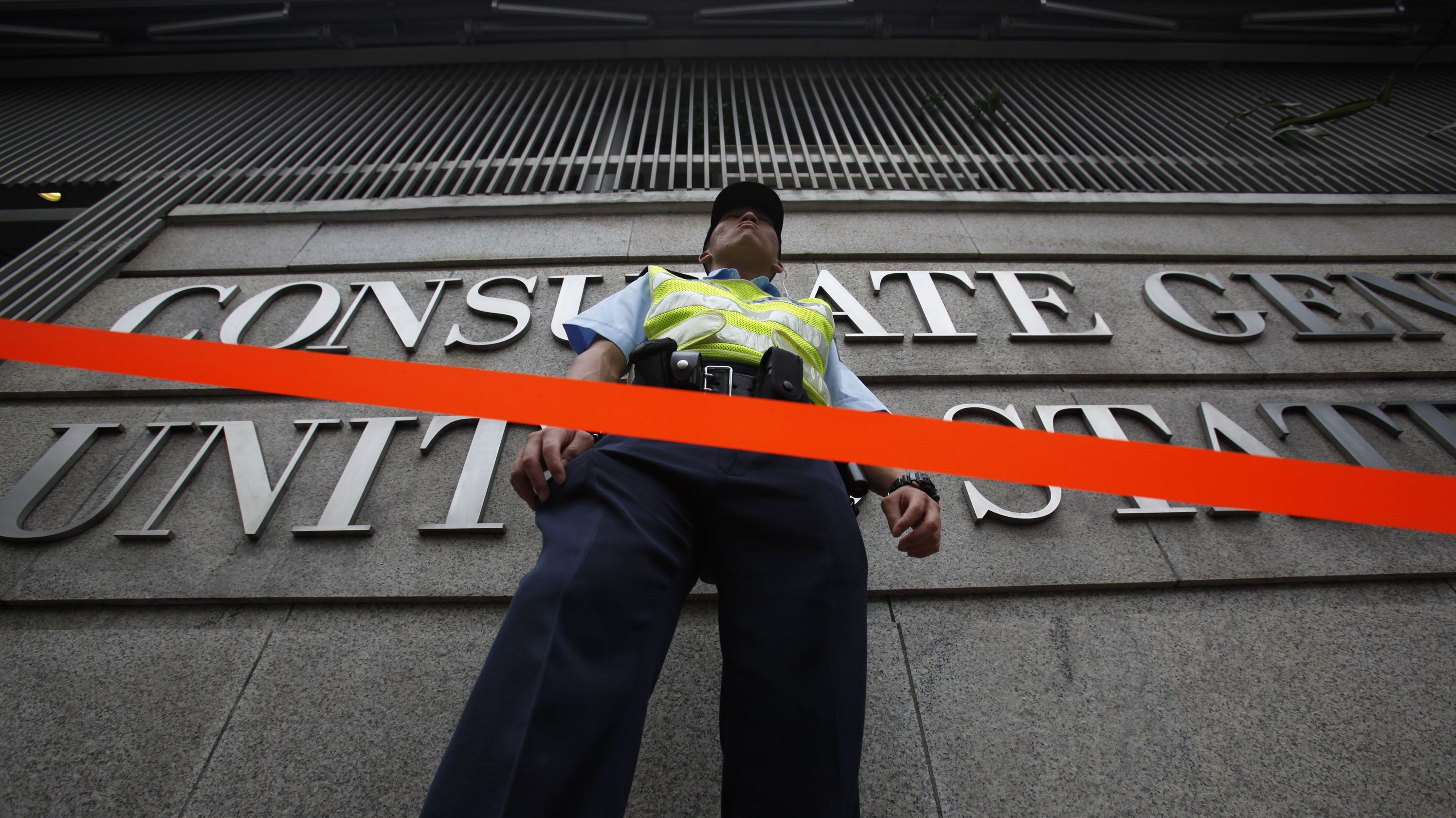 A policeman stands behind a cordon line outside the U.S. Consulate in Hong Kong