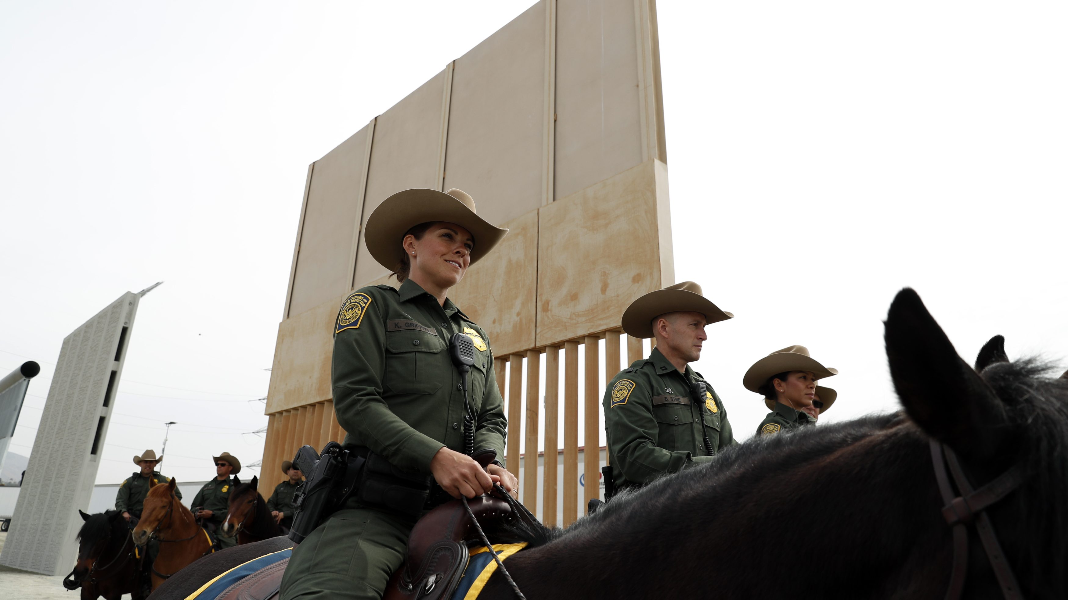 U.S. Customs and Border Protection Border Patrol Agents sit on horseback as U.S. President Donald Trump participated in a tour of U.S.-Mexico border wall prototypes
