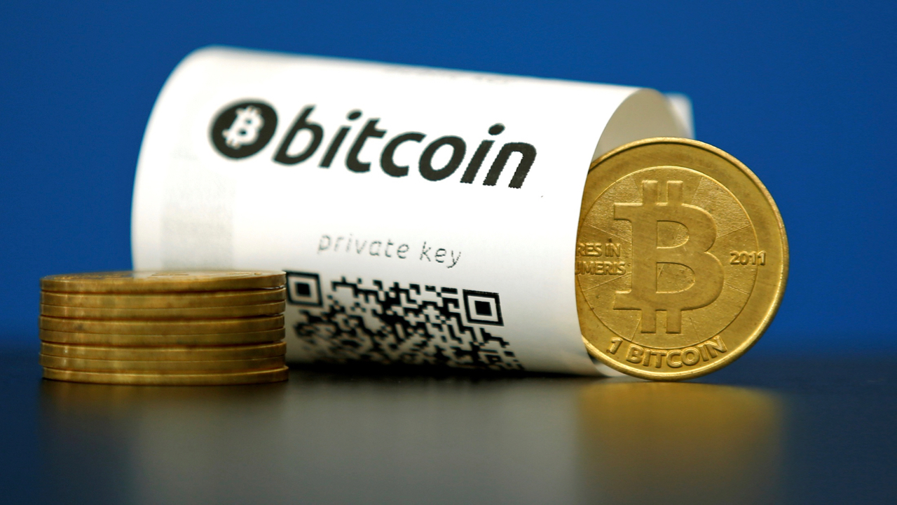 A Bitcoin (virtual currency) paper wallet with QR codes and a coin are seen in an illustration picture taken at La Maison du Bitcoin in Paris, France, May 27, 2015.  REUTERS/Benoit Tessier/File Photo - TM3EC521DQN01