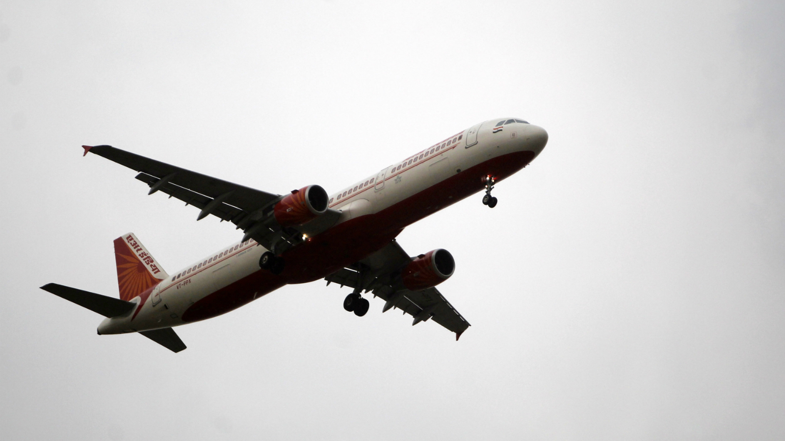 An Air India passenger jet approaches to land at Indira Gandhi International Airport in New Delhi, India, Monday, May 14, 2012. At least 300 Air India pilots walked out from their work for the past one week, leaving hundreds of passengers stranded at Delhi and Mumbai airports. Air India operates 450 international and domestic flights every day. May 14, 2012