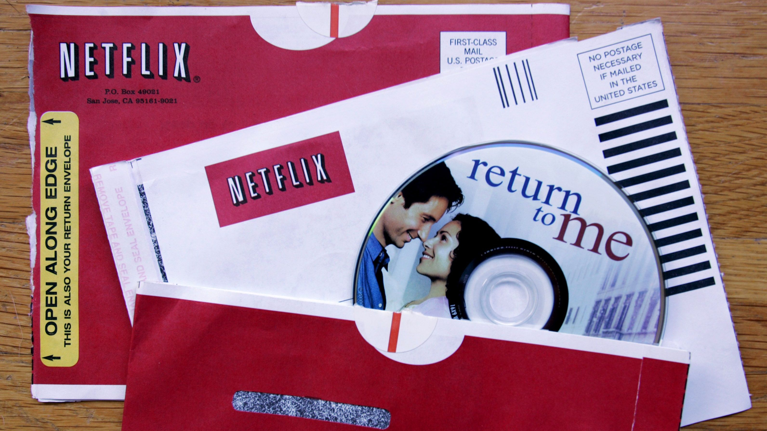 "Netflix envelopes and the DVD movie ""Return to Me"" is displayed at Netflix customer Coleman Garrett's home in Palo Alto, Calif., Friday, July 22, 2005. (AP Photo/Paul Sakuma)"