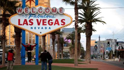Tourists take pictures in front of the Las Vegas welcome sign in Las Vegas, Thursday, Feb. 12, 2009.