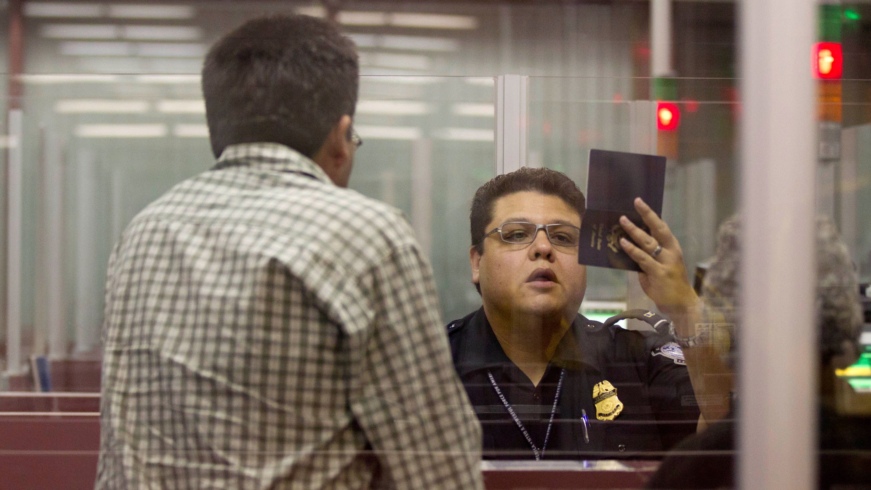 A Customs and Border Protection officer checks the passport of a non-resident visitor to the United States inside immigration control at McCarran International Airport, Tuesday, Dec. 13, 2011, in Las Vegas.   The U.S. Travel Association is pushing Congress to make it easier for foreigners to visit the United States. Nearly 7.6 million nonimmigrant visas were issued in 2001, compared to fewer than 6.5 million in 2010. Tourism leaders in the United States say the decline symbolizes a diplomacy failure that is costing American businesses $859 billion in untapped revenue. ()