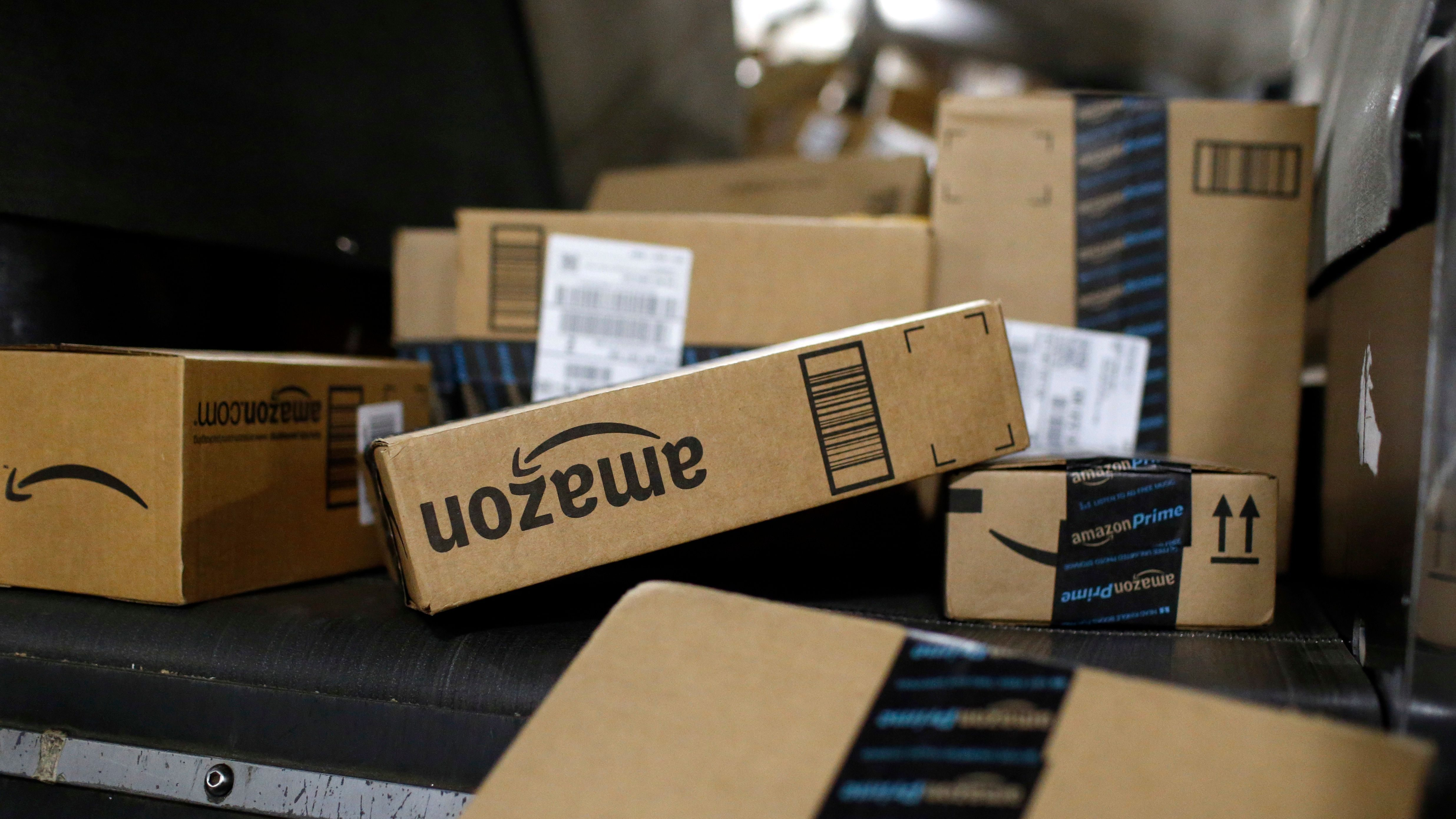 In this Nov. 20, 2015, photo, packages being shipped in Amazon boxes ride a conveyor belt at the UPS Worldport hub in Louisville, Ky. Amazon is already a huge part of many people's lives. And its $13.7 billion deal for the organic grocer Whole Foods will likely bind its customers even more tightly. While Amazon is the clear leader in e-commerce, 90 percent of worldwide retail spending is still in brick-and-mortar stores, according to eMarketer. (AP Photo/Patrick Semansky)