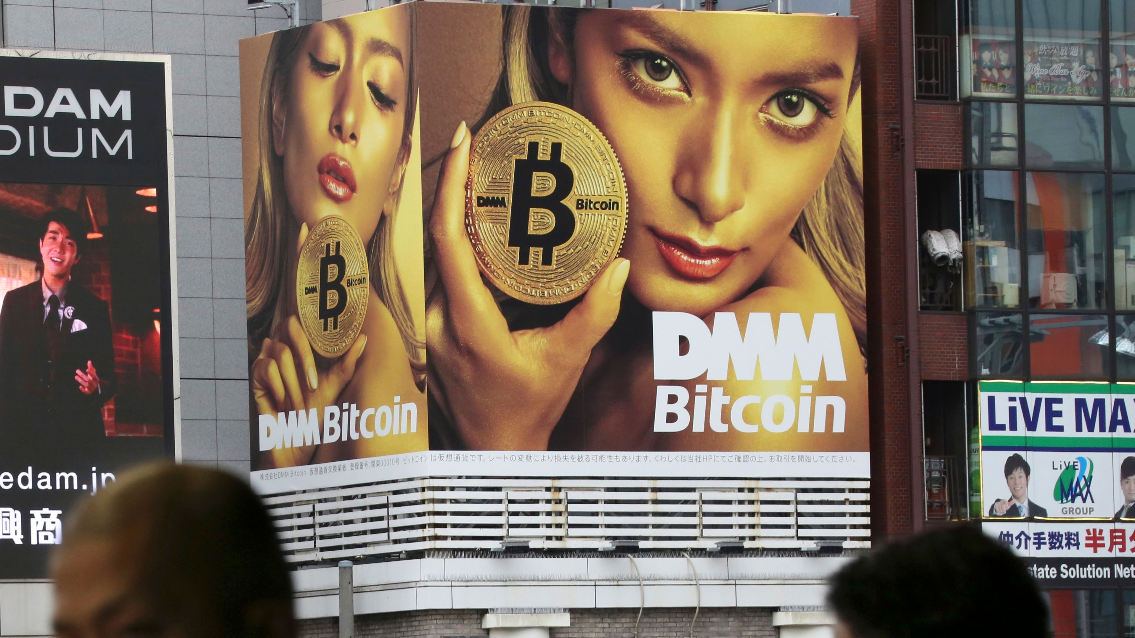 A huge advertisement of Bitcon is displayed near a train station in Tokyo Monday, Jan. 29, 2018. Blockchain is a decentralized technology that can make transactions safe and secure, but crypto-currency exchanges that trade bitcoins and other virtual currencies that are based on this technology have been hacked because they are not working on secure networks.