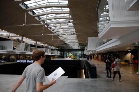 A man enters the world's biggest start-up incubator Station F, in Paris, Wednesday, Jan. 31, 2018. For a glimpse at President Emmanuel Macron's vision for the new French economy, look no farther than Station F. Entrepreneurs don virtual reality goggles and share ideas with business angels in this old Paris train station-turned-startup incubator. (AP Photo/Christophe Ena)