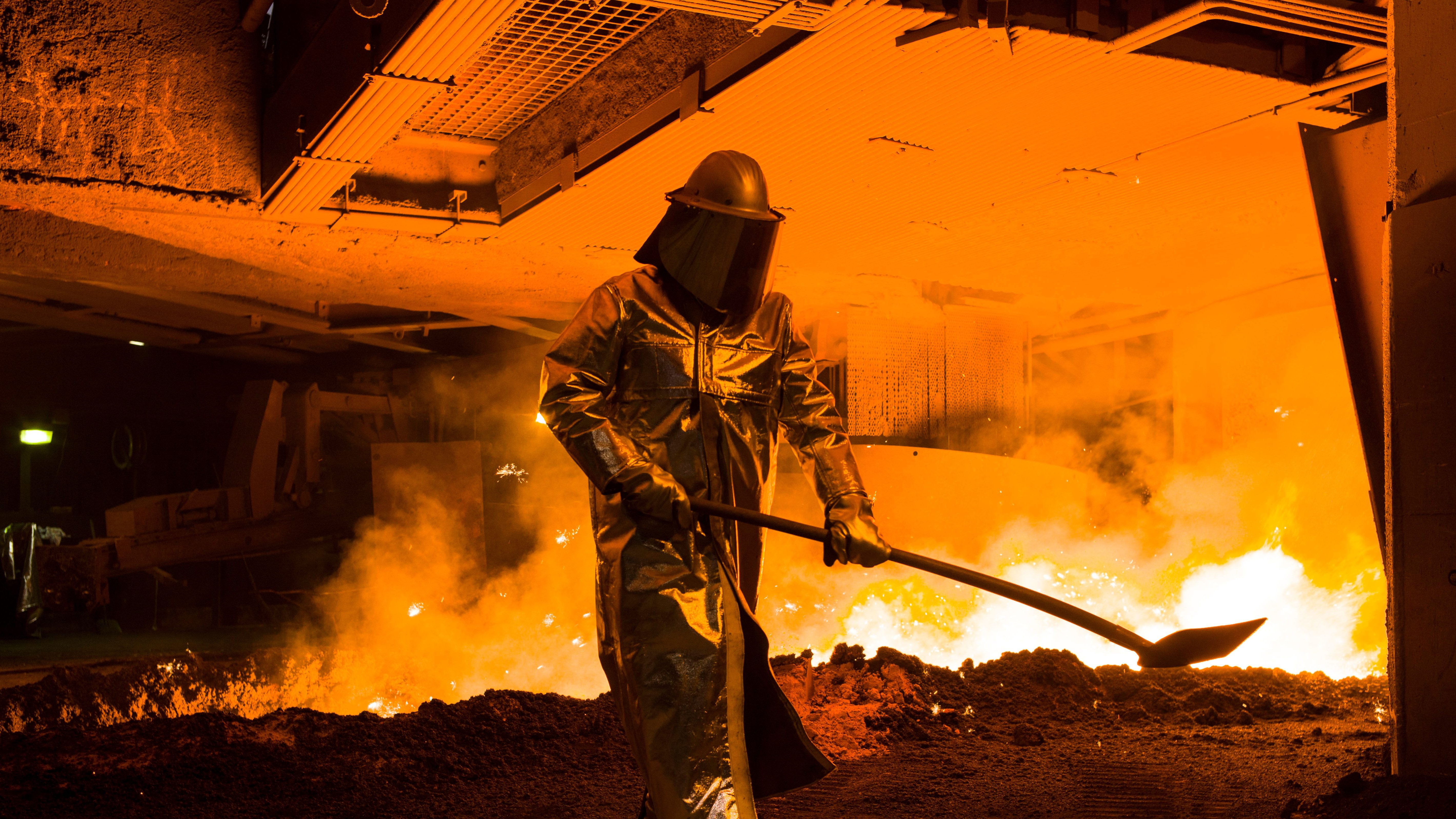 Germany Steel Tariffs: An employee in protective clothing works at the furnace  at the steel producer