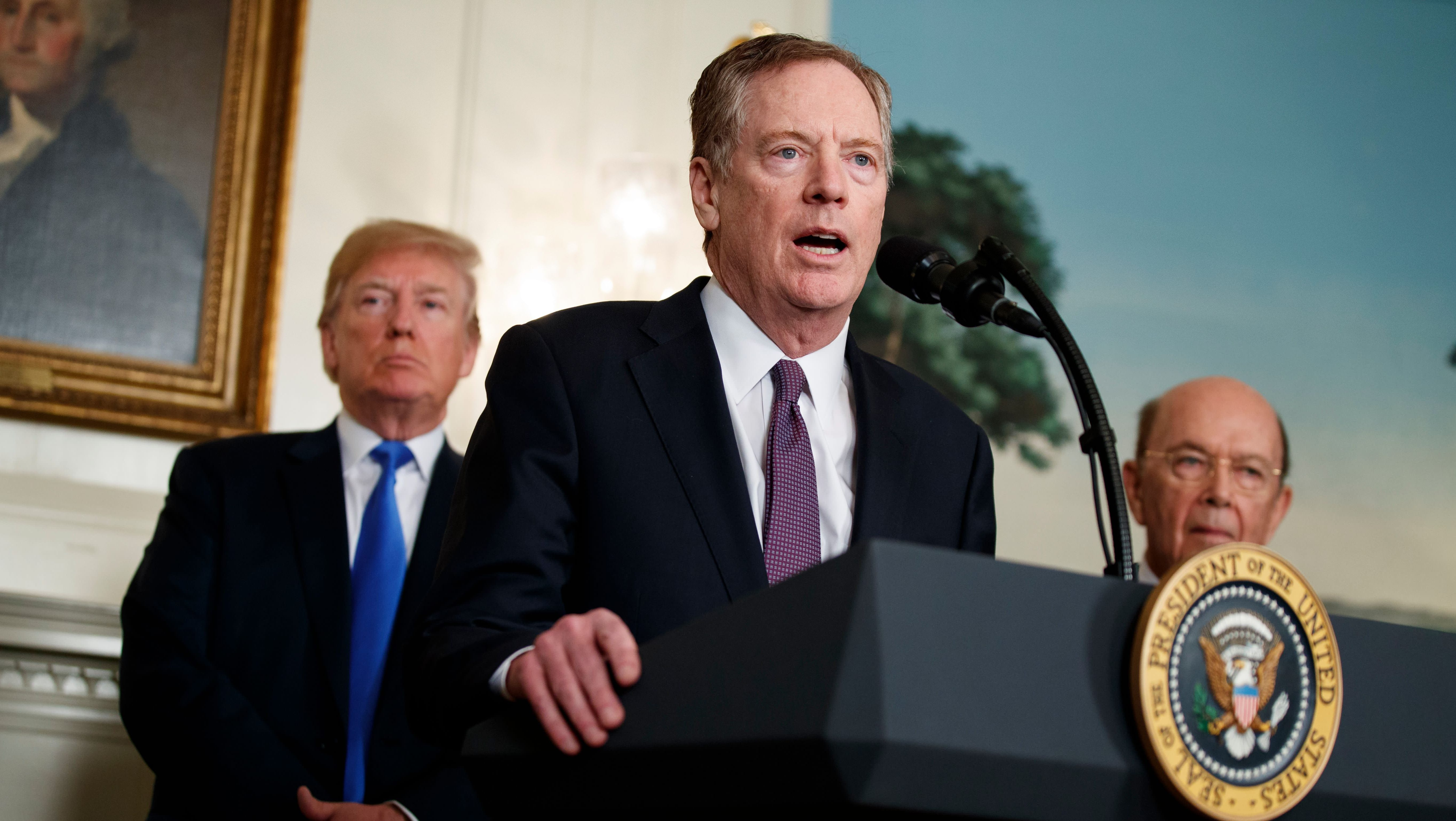 President Donald Trump, left, and Secretary of Commerce Wilbur Ross, right, listen to United States Trade Representative Robert Lighthizer speak during an event to announce tariffs and investment restrictions on China, in the Diplomatic Reception Room of the White House, Thursday, March 22, 2018, in Washington. (AP Photo/Evan Vucci)