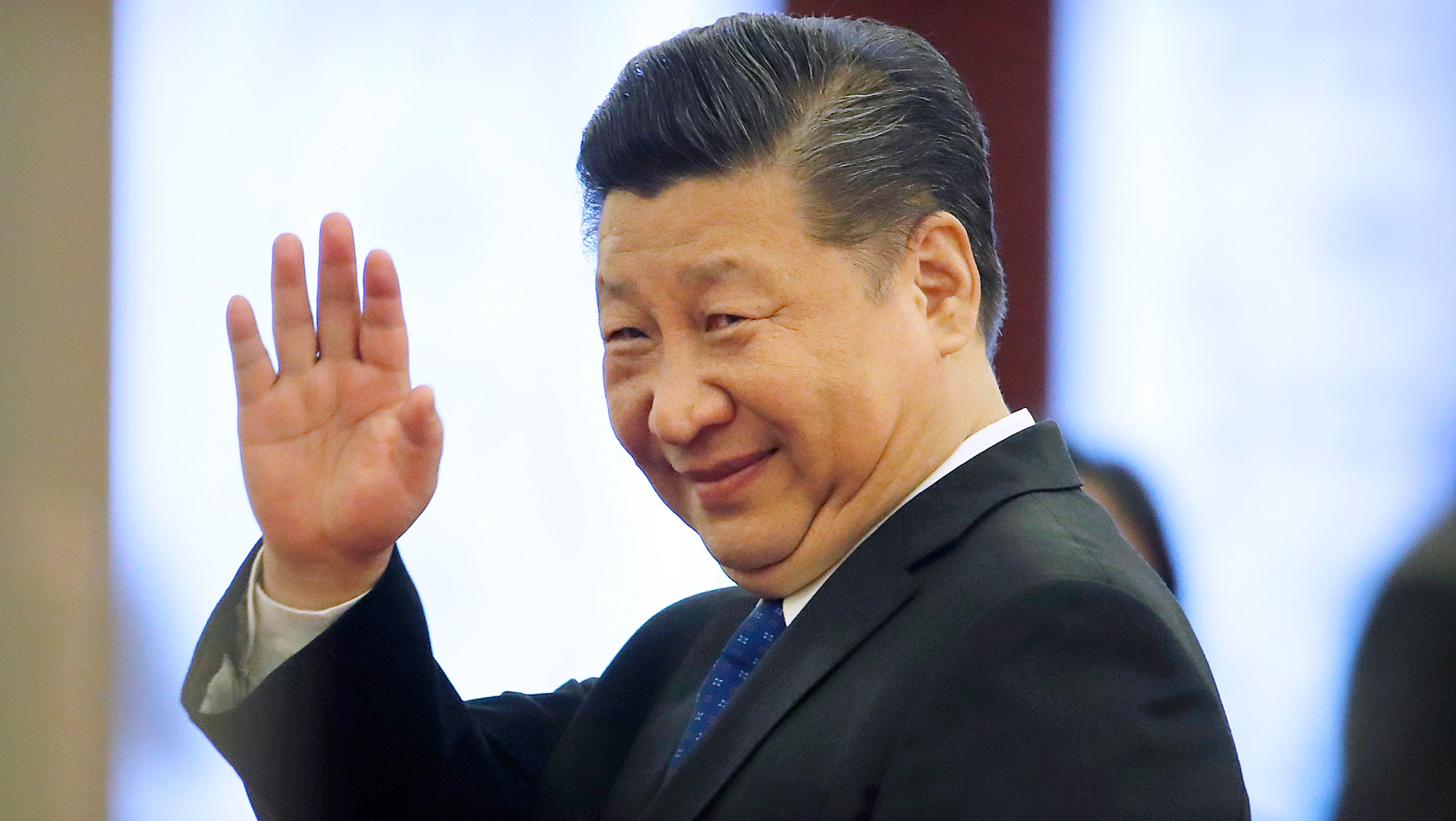 Chinese President Xi Jinping waves as he leaves a welcome ceremony at the Great Hall of the People in Beijing, Thursday, March 29, 2018. (AP Photo/Mark Schiefelbein)