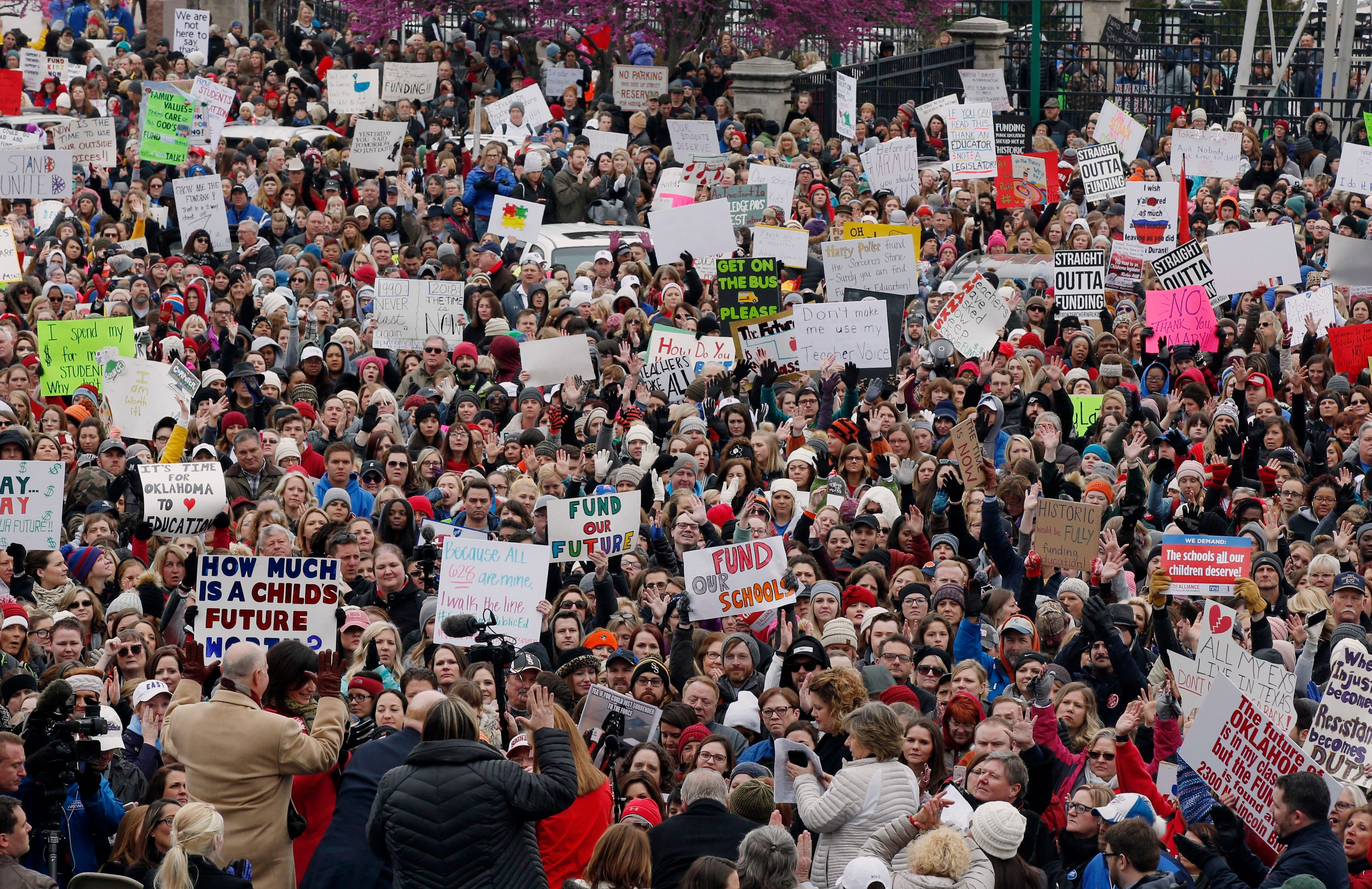 The crowd cheers during a teacher rally at the state Capitol in Oklahoma City, Monday, April 2, 2018. Teachers were holding separate protests in Oklahoma and Kentucky on Monday to voice dissatisfaction with issues like pay and pensions. (AP Photo/Sue Ogrocki)
