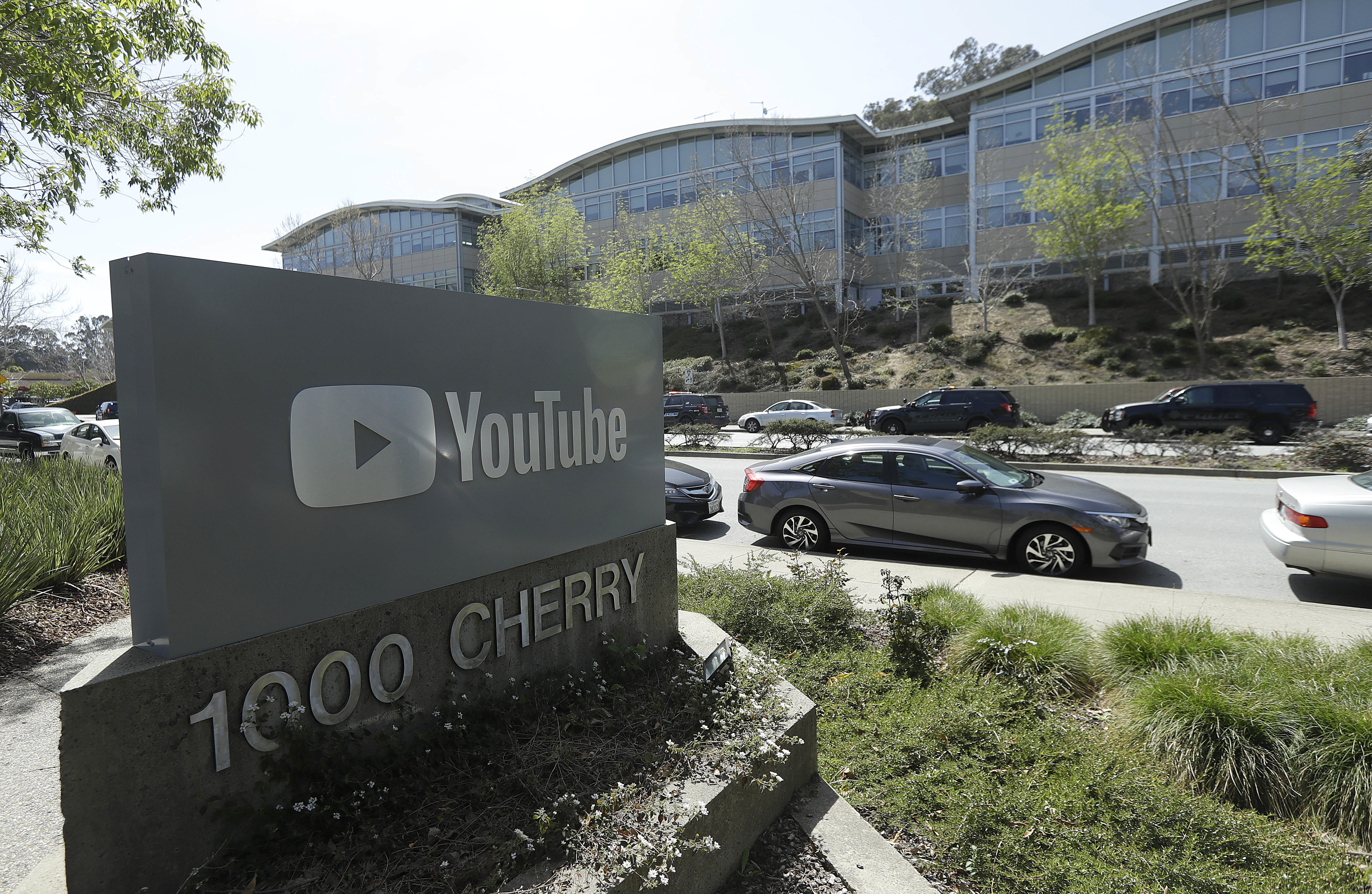 A YouTube sign is shown across the street from the company's offices in San Bruno, Calif., Tuesday, April 3, 2018. A woman opened fire at YouTube headquarters Tuesday, setting off a panic among employees and wounding several people before fatally shooting herself, police and witnesses said.