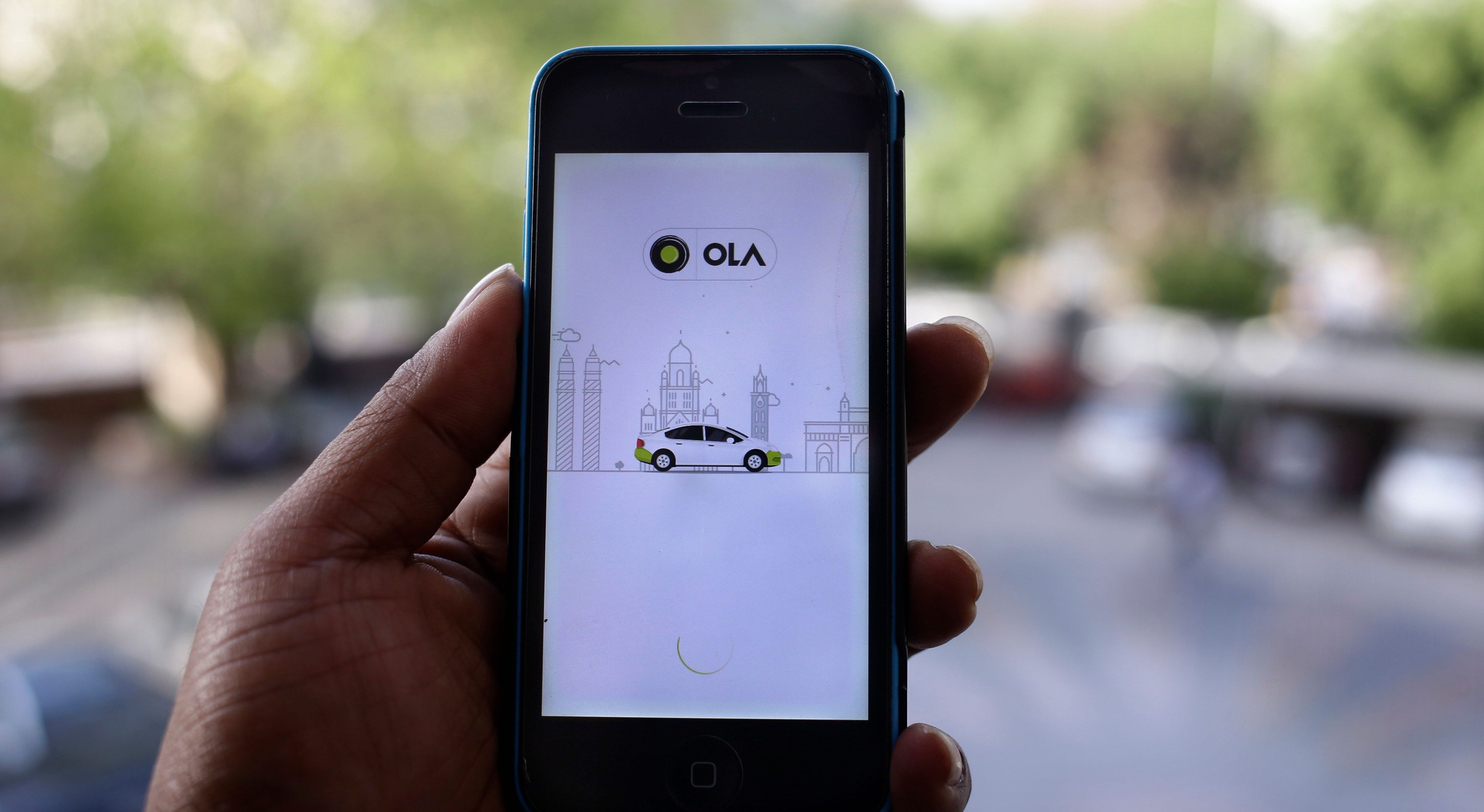 Ola's cab-hailing smartphone app is seen on a mobile phone in New Delhi, India, Tuesday, March 29, 2016. Aiming to wrest control of India's booming taxi market, two cab-hailing smartphone apps _ Uber and Ola _ are promising hundreds of millions in new investment while also facing off with one another in court.