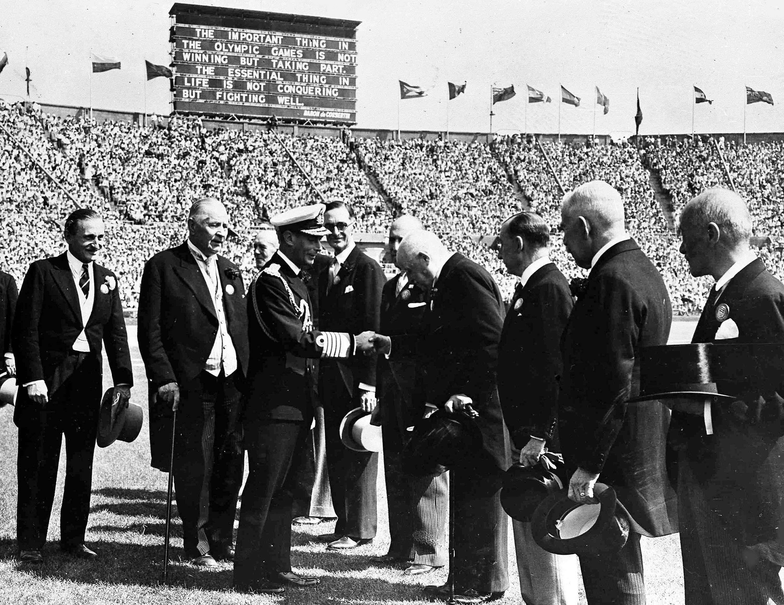Britain's King George VI, in naval uniform, shakes hands with members of the International Olympic Committee during the opening ceremony of the XIV Summer Olympic Games, at Wembley Stadium, London, July 29, 1948. (AP Photo)