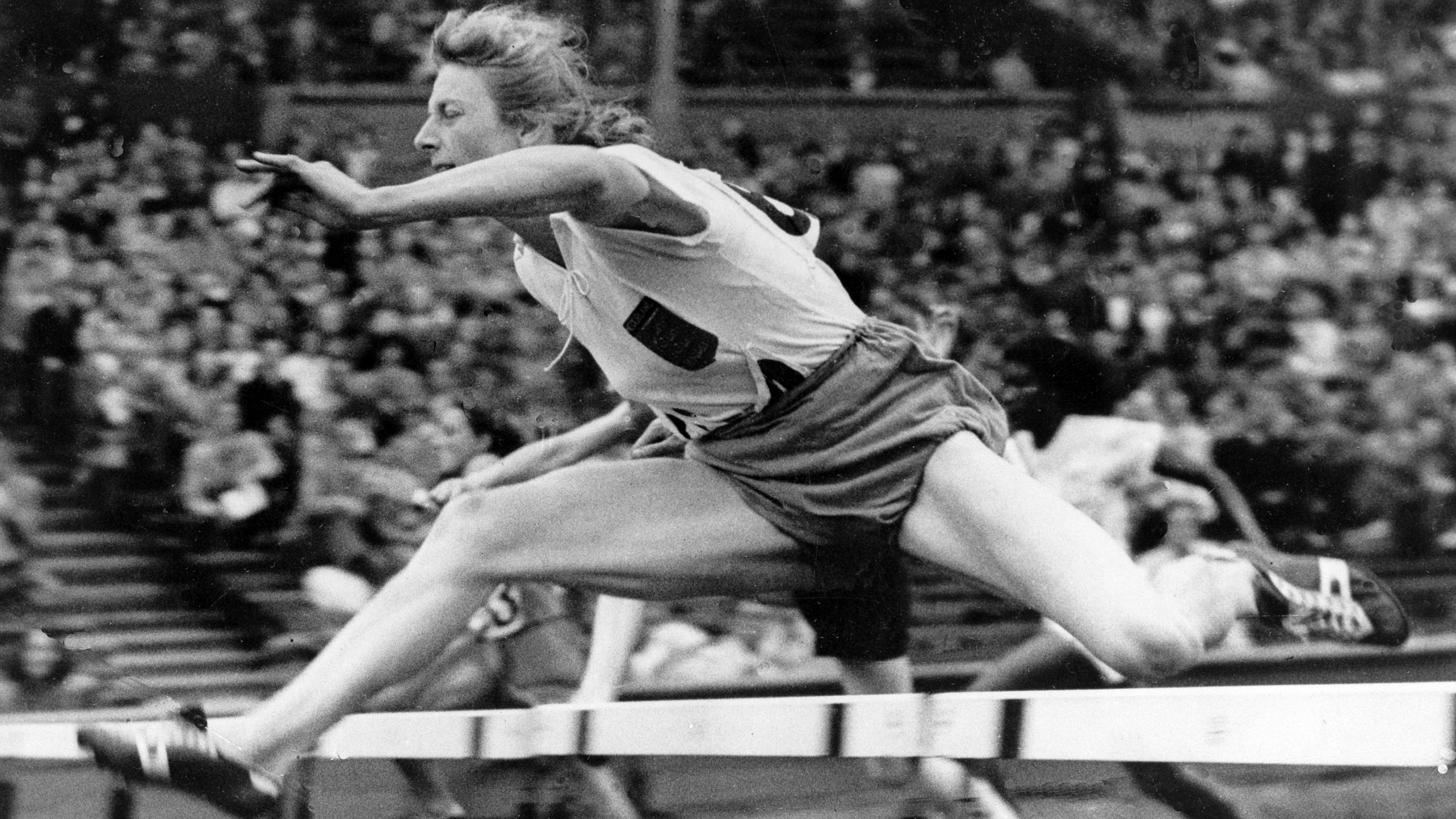 Mrs. Fanny Blankers-Koen, the Dutchwoman, winning the last lap of the 400 meters relay final at Wembley Stadium in London, United Kingdom, on August 7, 1948, to make Holland the winners of the event in 47.5 sec. Also in picture is H.H. Nissen of Denmark who came second with USA third. (AP Photo)