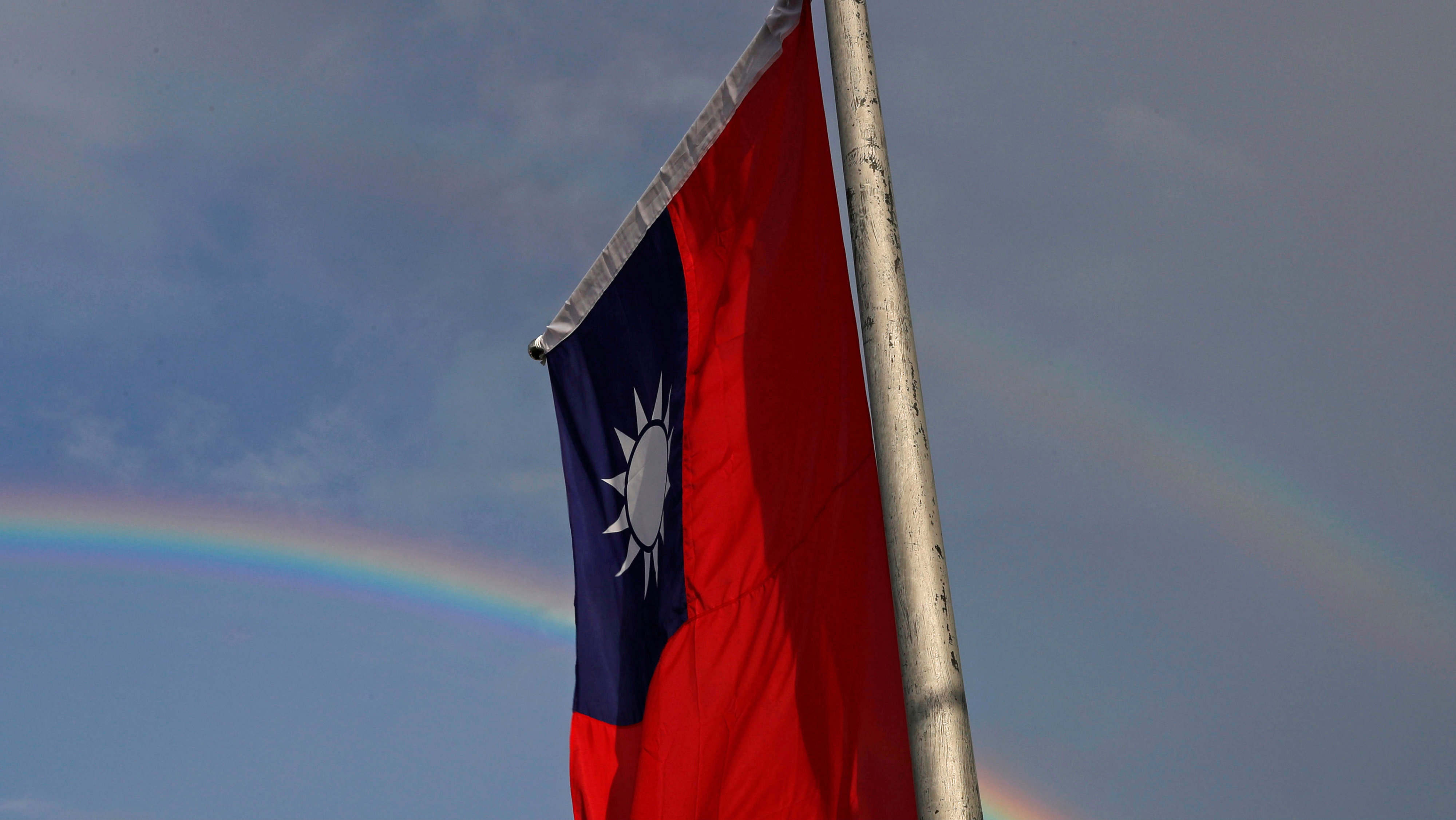 A double rainbow is seen behind Taiwanese flag during the National Day celebrations in Taipei, Taiwan