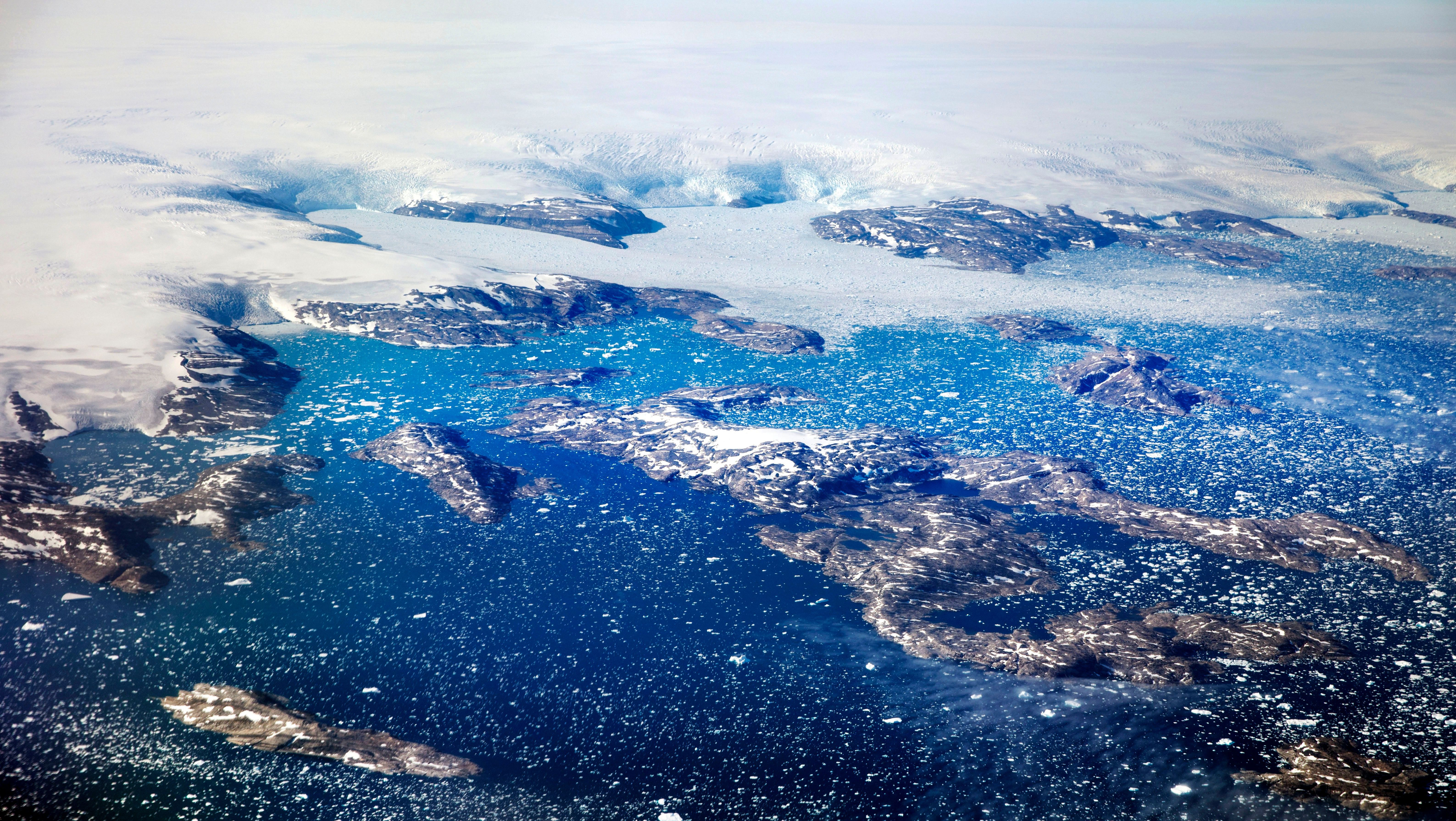 Icebergs calving off the Greenland ice sheet.