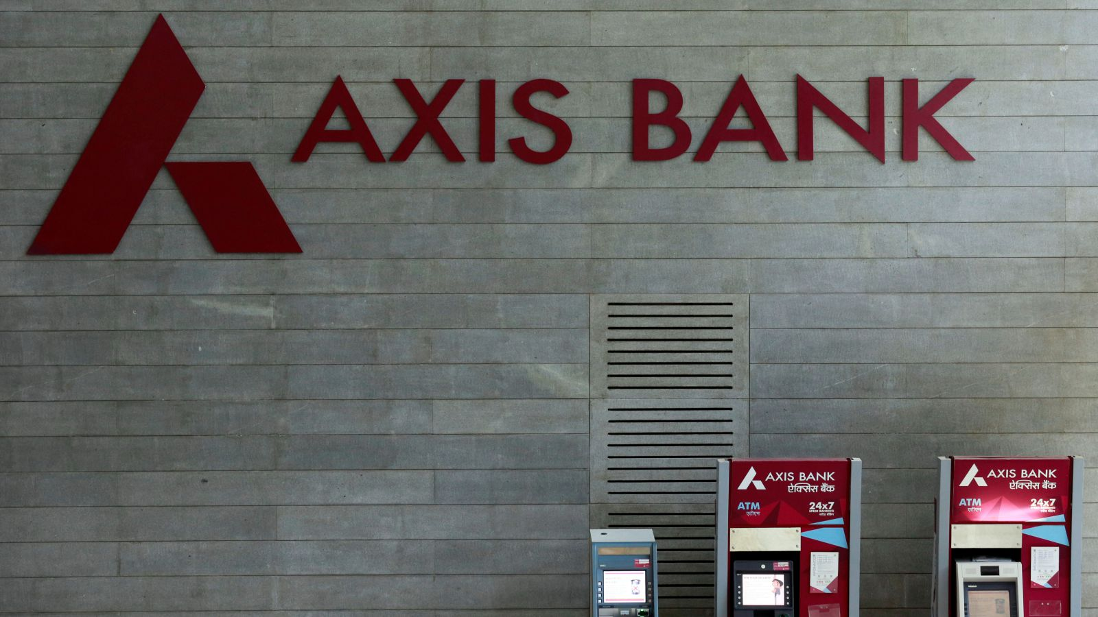 Axis Bank's logo is seen next to ATM machines at its corporate headquarters in Mumbai, India July 25, 2017.