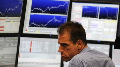 Trader in front of screens
