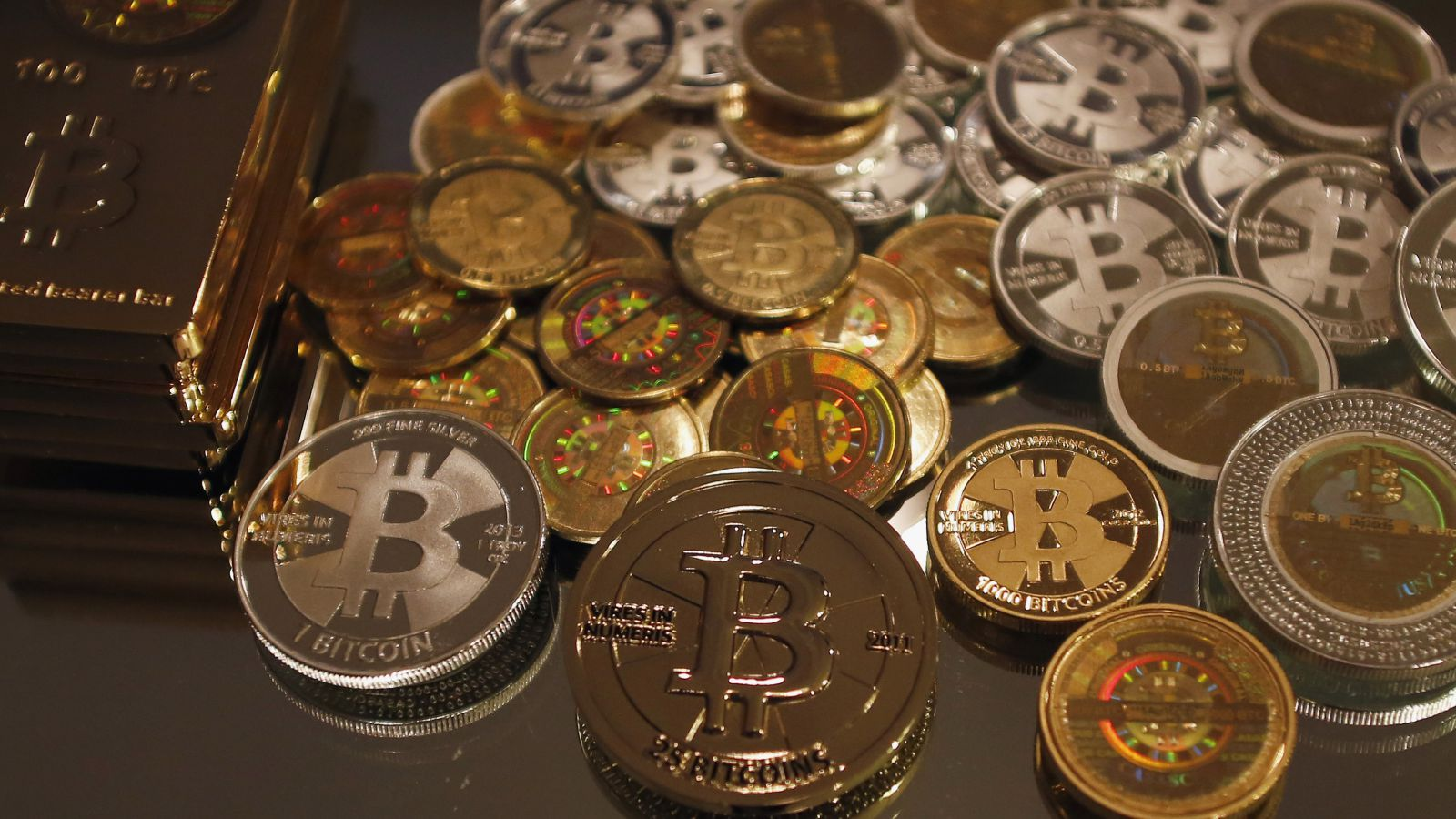 Some of Bitcoin enthusiast Mike Caldwell's coins are pictured at his office in Sandy, Utah, September 17, 2013.Caldwell produces physical coins Bitcoins, which have been around since 2008, and have become a form of electronic money that can be exchanged without using traditional banking or money transfer systems. Bitcoins, touted by some experts as the future of money, gained in prominence during Europe's financial crisis as more people questioned the safety of holding their cash in the bank.