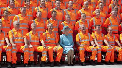 Queen Elizabeth poses for a photo with British construction workers