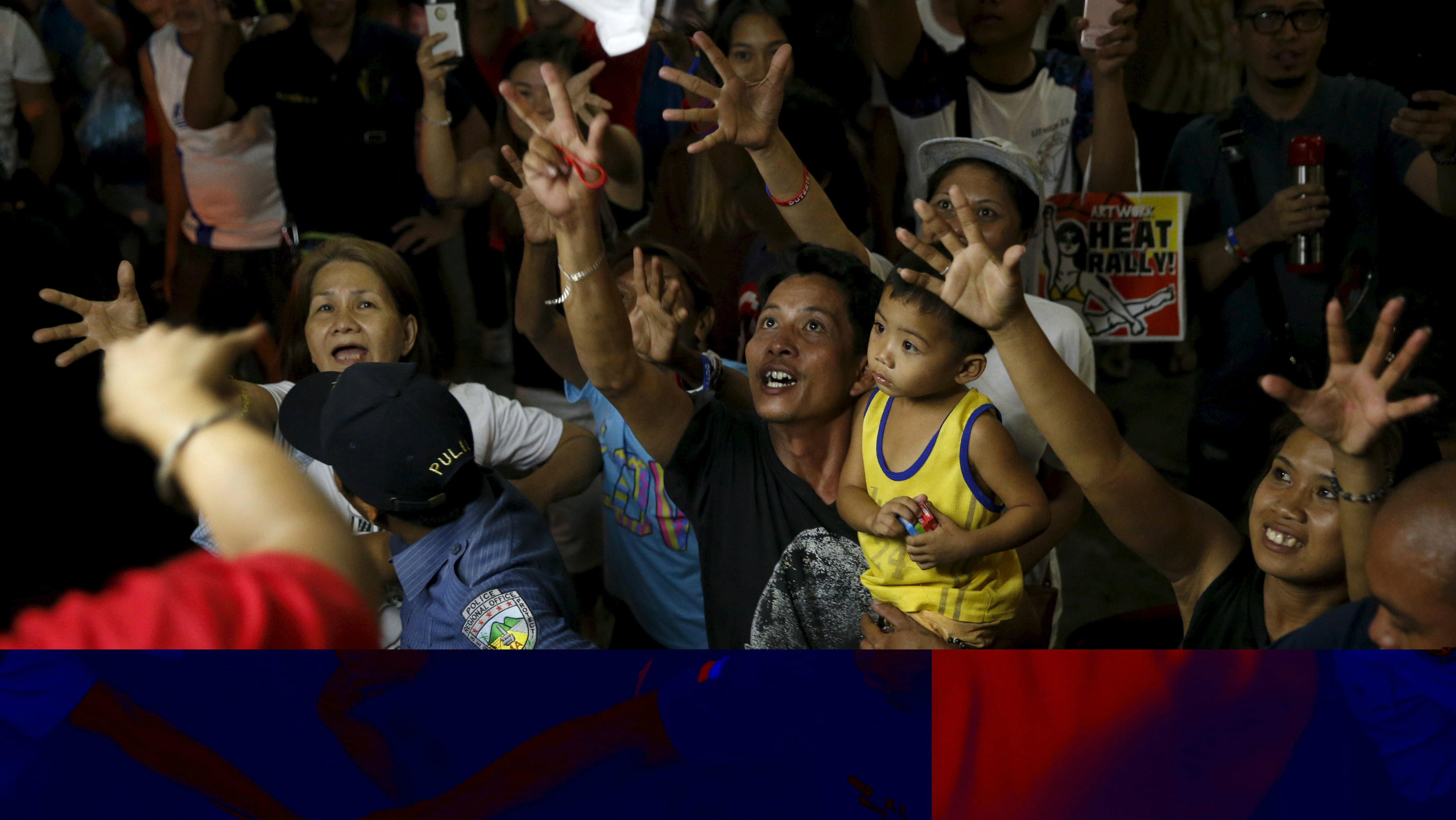 Supporters of presidential candidate Rodrigo Duterte try to catch election souvenirs during an election campaigning for May 2016 national elections in Silang, Cavite southwest of Manila Philippines