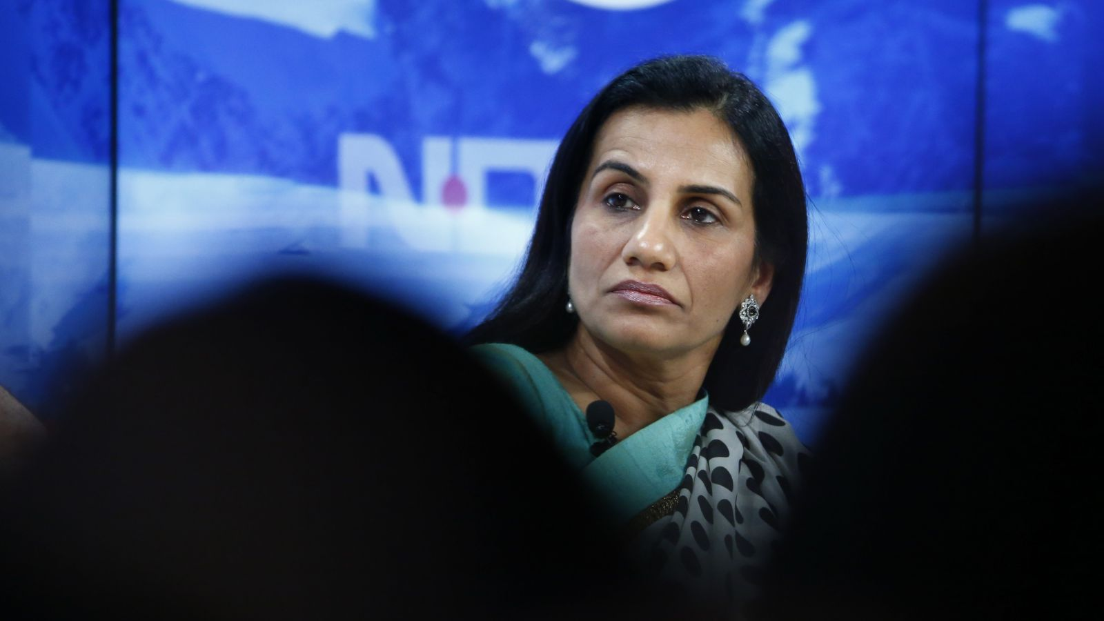 handa Kochhar, Managing Director and Chief Executive Officer of ICICI Bank listens during the session 'India's Next Decade' in the Swiss mountain resort of Davos January 23, 2015. More than 1,500 business leaders and 40 heads of state or government attend the Jan. 21-24 meeting of the World Economic Forum (WEF) to network and discuss big themes, from the price of oil to the future of the Internet. This year they are meeting in the midst of upheaval, with security forces on heightened alert after attacks in Paris, the European Central Bank considering a radical government bond-buying programme and the safe-haven Swiss franc rocketing.