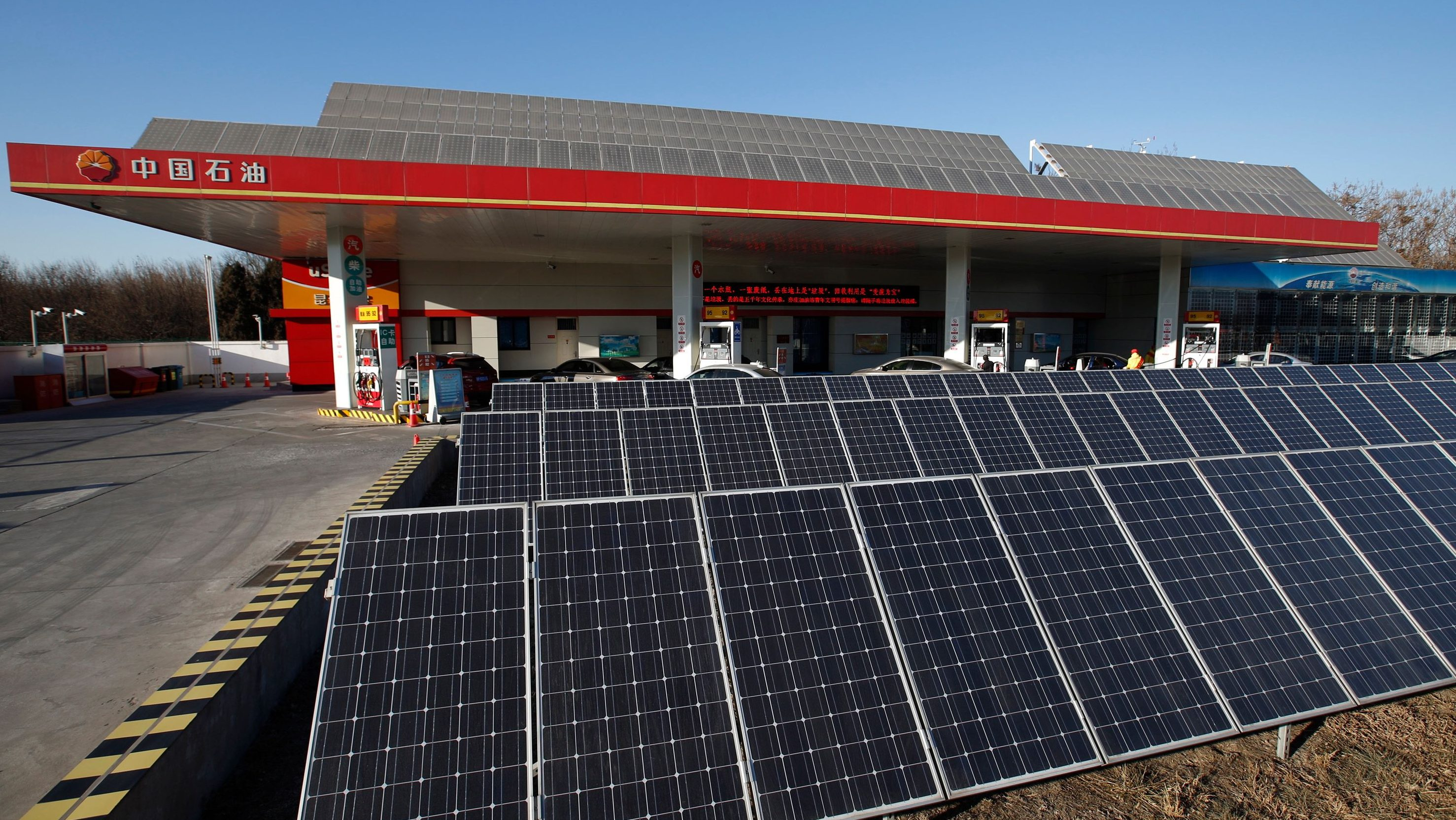 Solar panels are seen at PetroChina's solar-powered Yizhuang gas station in Beijing, January 9, 2015. Reuters photographers from Mali to Mexico have shot a series of pictures of fuel stations. Whether it is plastic bottles by the roadside in Malaysia or a futuristic forecourt in Los Angeles, fuel stations help define our world. Oil prices steadied above $48 a barrel on Tuesday, recovering from earlier losses as the dollar weakened against the euro. Oil prices have dropped nearly 60 percent since peaking in June 2014 on ample global supplies from the U.S. shale oil boom and a decision by OPEC to keep its production quotas unchanged.