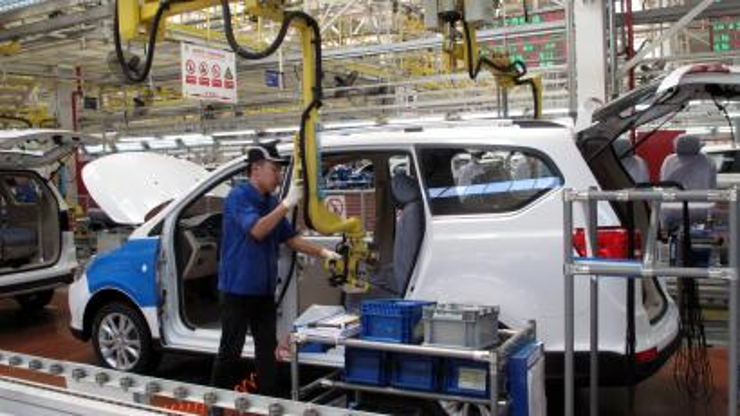 Employees work at a production line inside a factory of Saic GM Wuling, in Liuzhou, Guangxi Zhuang Autonomous Region, China, June 19, 2016.