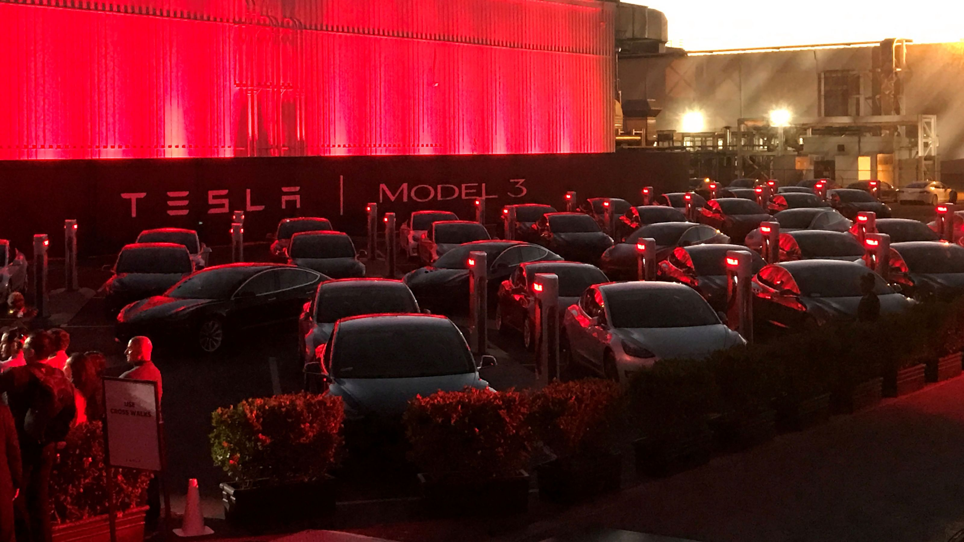 Tesla Model 3 cars wait for their new owners as they come off the Fremont factory's production line during an event at the company's facilities in Fremont, California, U.S.