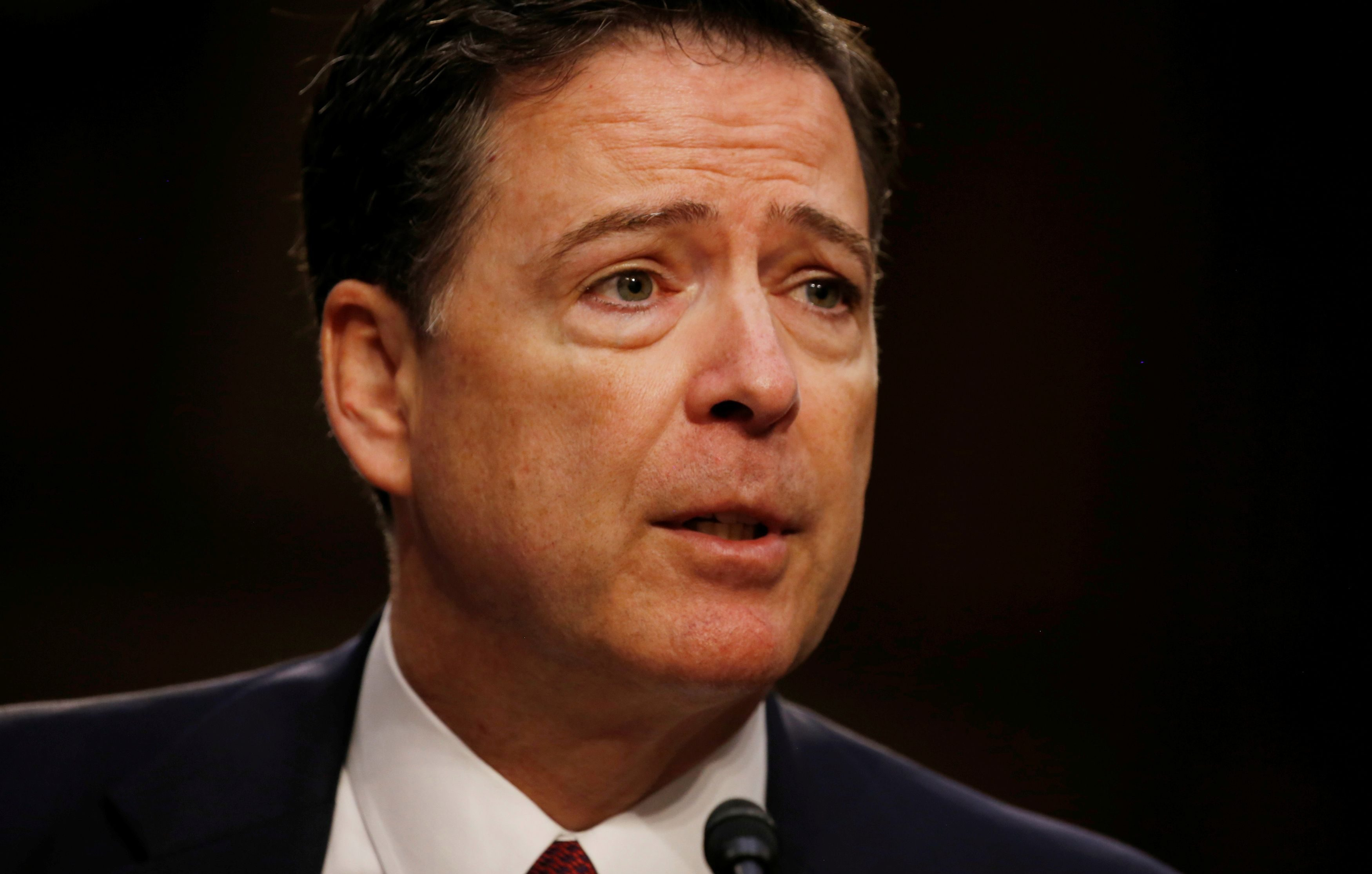 Former FBI Director James Comey testifies before a Senate Intelligence Committee hearing on Russia's alleged interference in the 2016 U.S. presidential election on Capitol Hill in Washington, U.S., June 8, 2017.   REUTERS/Jonathan Ernst/File Photo - RC1A34315600