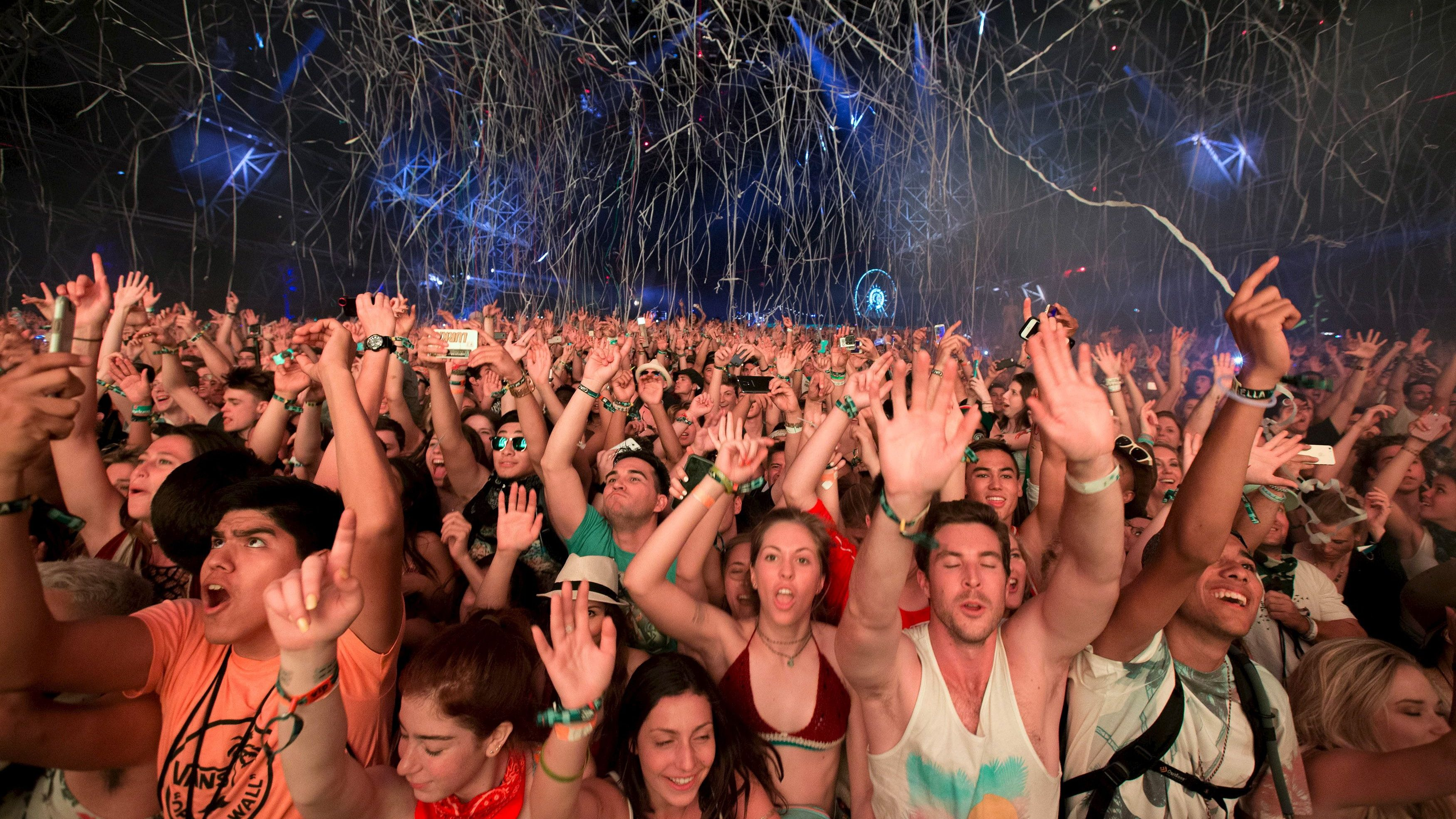 Fans listen to David Guetta at the Coachella Valley Music and Arts Festival in Indio, California April 12, 2015.
