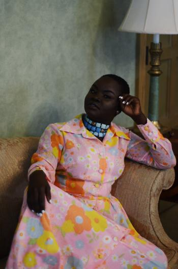 african woman sitting in a fashionable dress