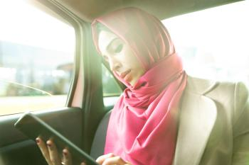 woman in headscarf working in a taxi