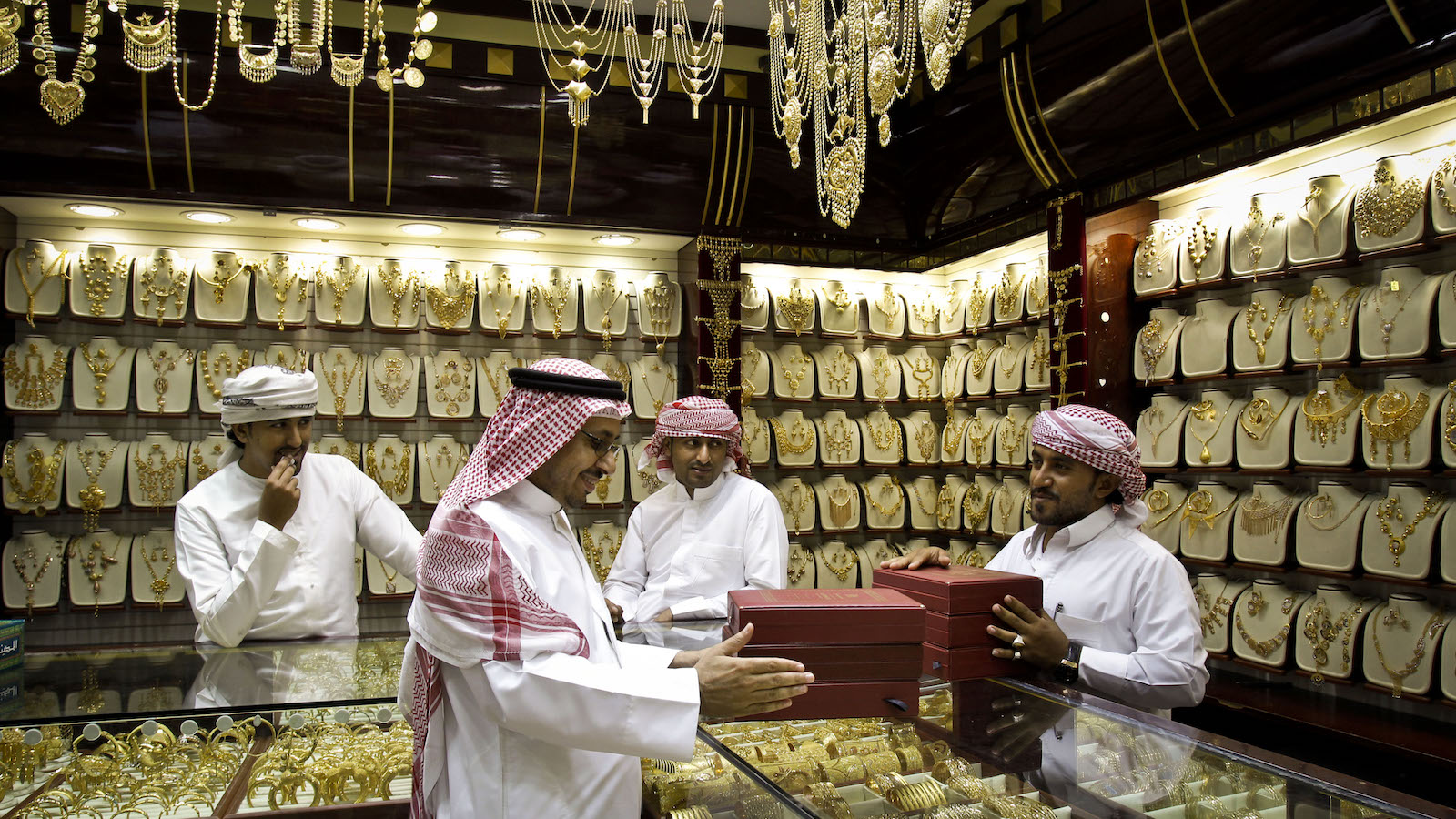 In this Thursday Oct. 11, 2012 photo, a Saudi customer discusses his purchases at a jewelry shop in the gold suq, or market, in Dubai, United Arab Emirates. The price of gold in Dubai is fixed daily and items are sold by weight. with little or no or little charge for the often exquisite workmanship. (AP Photo/Kamran Jebreili)