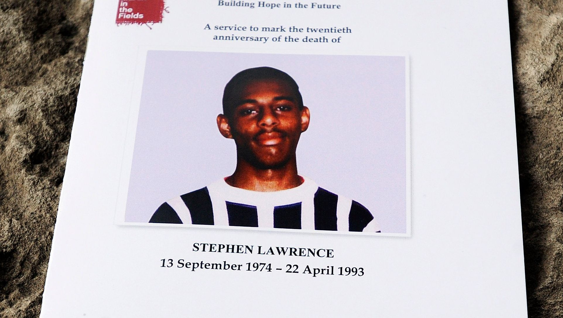 epa03673014 An order of service is shown at a memorial service at St Martins-in-the-Fields Church in Trafalgar Square, central London, England, 22 April 2013, for Stephen who was murdered 20 years to the day. Stephen Lawrence, aged 18, was stabbed to death by a gang of white youths in an unprovoked attack while waiting for a bus in south-east London in April 1993.  EPA/FACUNDO ARRIZABALAGA