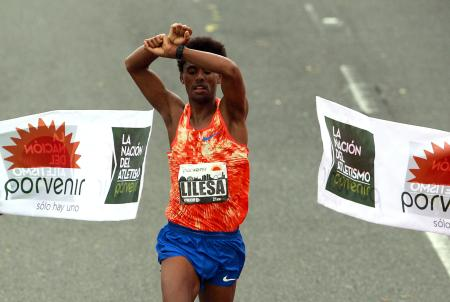 Ethiopian Feyisa Lilesa, current Olympic runner-up, was crowned champion of the Half Marathon of Bogota, Colombia, 30 July 2017. Feyisa Lilesa clasped his hands above his head in protest of the government's repression against his tribe when he crossed the line, just as he did at the Rio Olympics.