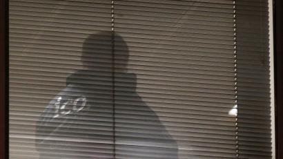 A person is seen inside the building which houses the offices of Cambridge Analytica as investigators from Britain's Information Commissioners Office entered, following the granting of a search warrant by a High Court judge, in London