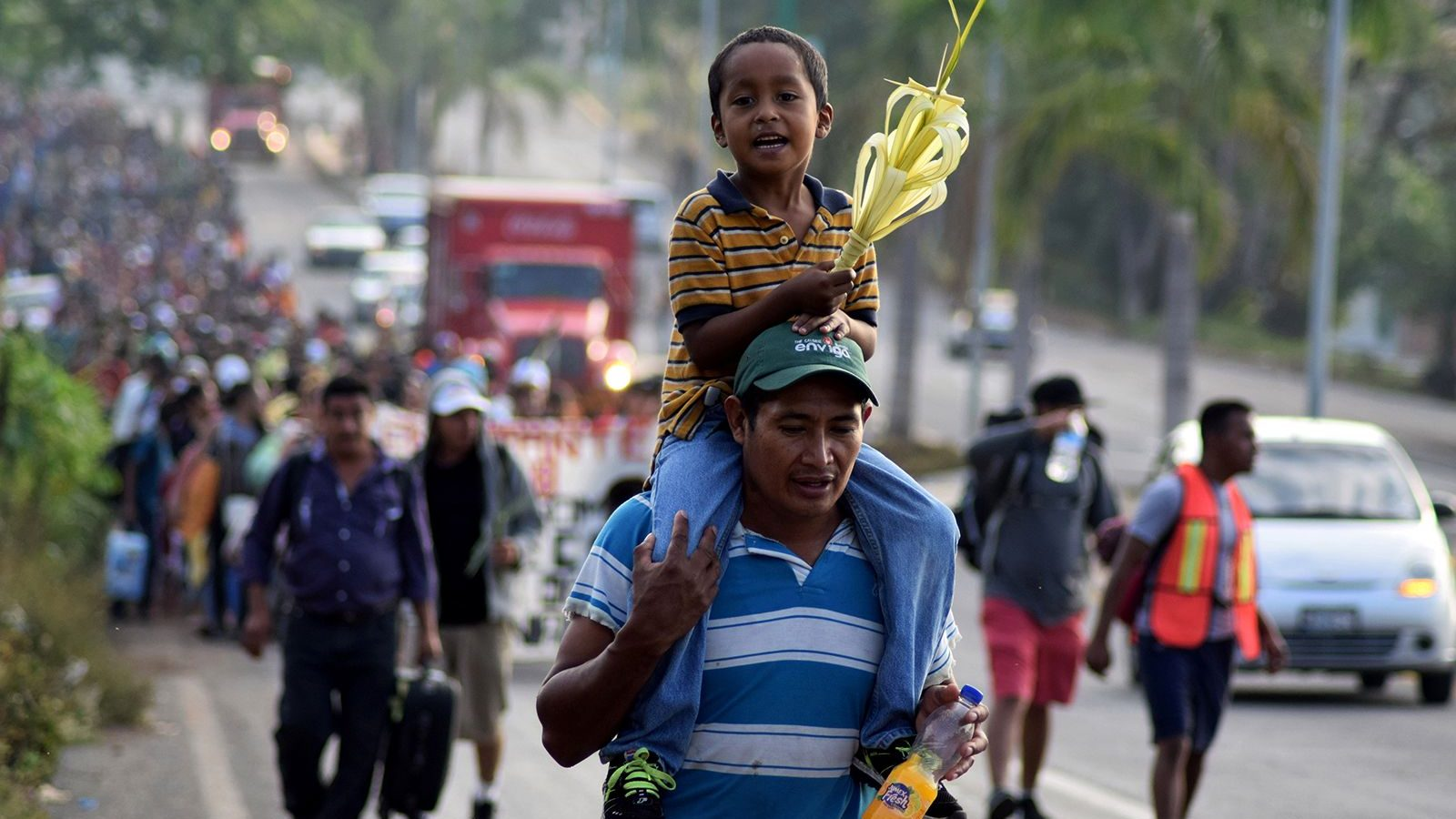 Hundreds of Central Americans take part in a Via Crucis on Palm Sunday in Tapachula