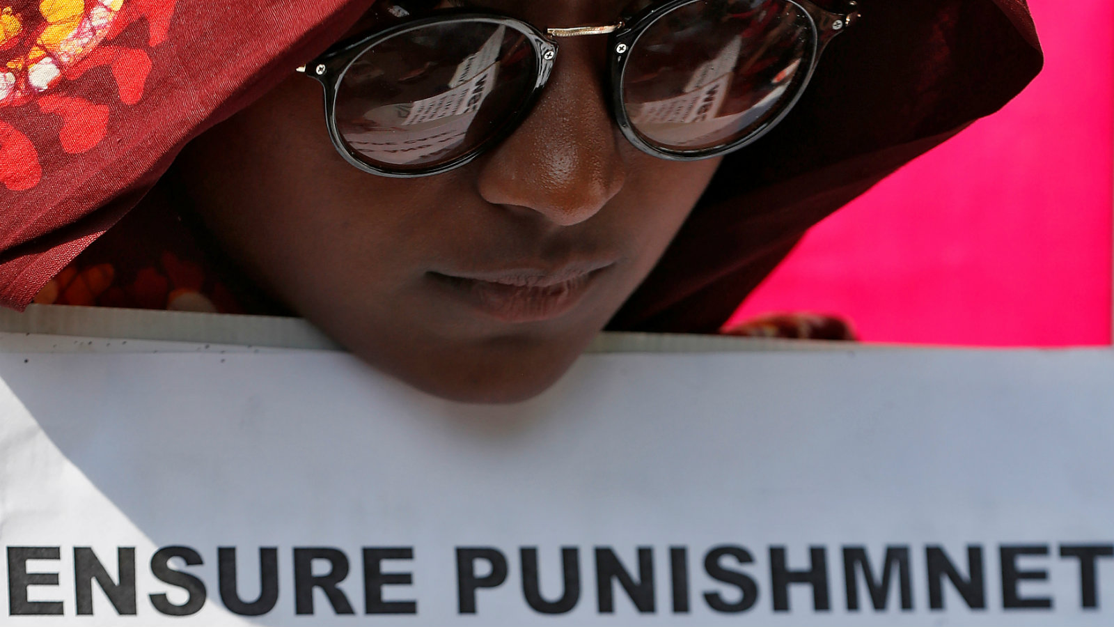 A woman holds a placard at a protest against the rape of an eight-year-old girl, in Kathua, near Jammu and a teenager in Unnao, Uttar Pradesh state, in New Delhi, India April 12, 2018.