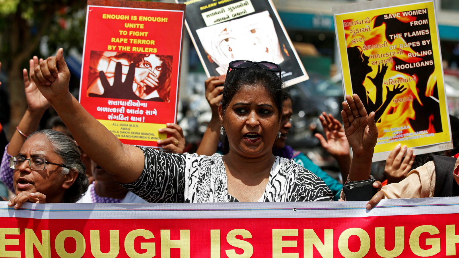 People hold placards at a protest against the rape of an eight-year-old girl, in Kathua, near Jammu and a teenager in Unnao, Uttar Pradesh state, in Ahmedabad, India April 13, 2018.