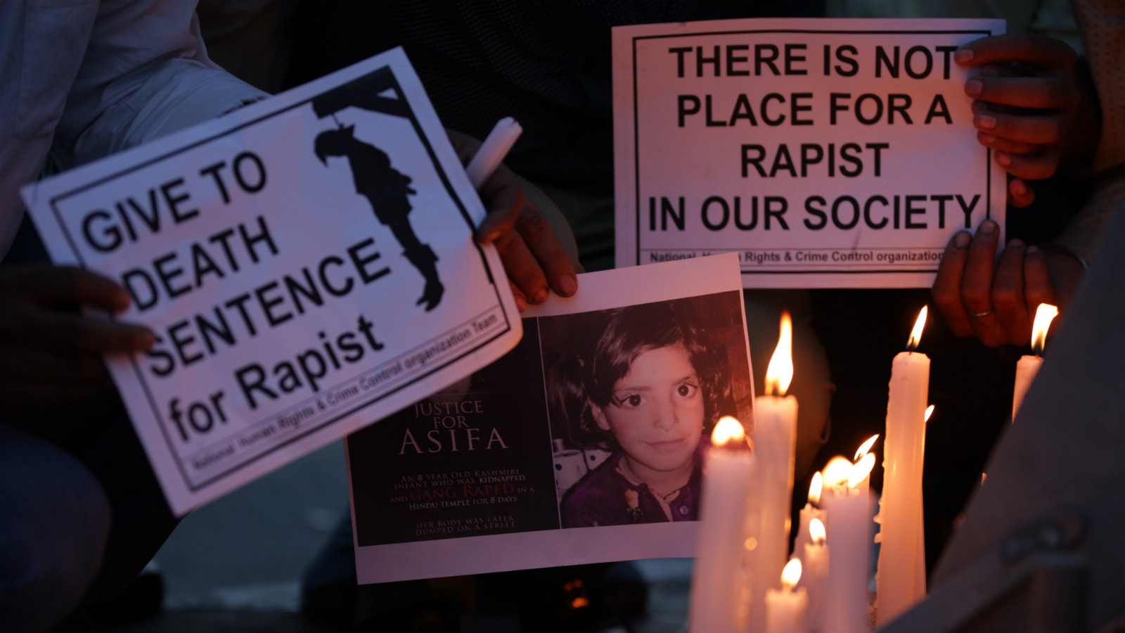 Indian people hold photos of Asifa Bano and candles during a candle light march to protest against the rape and murder of eight-year-old girl in Kathua, in Amritsar, India, 15 April 2018. Indian people staged various protests to bring attention to rape cases and violence against women in India, after an eight-year-old girl was gang raped and murdered, in Kathua. Protesters demanded justice for the victim and action against the accused.