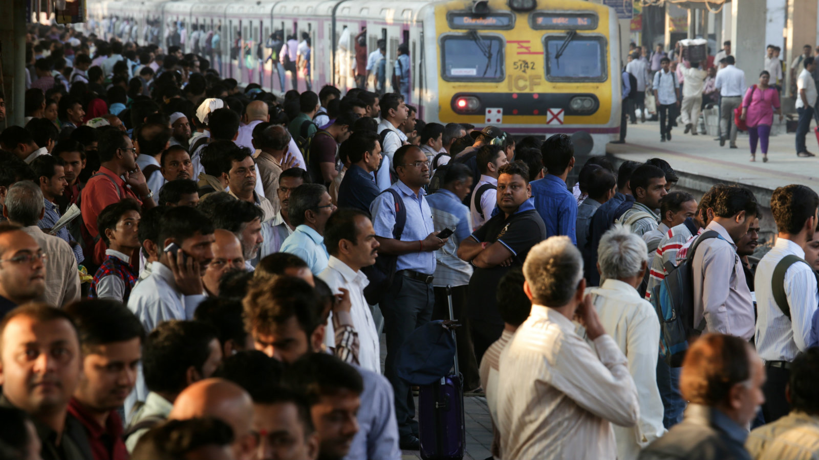Commuters wait to board a local train in Mumbai, India, 01 February 2017. Indian Finance Minister Arun Jaitley presented the Union Budget 2017 in New Delhi and for the first time the Railway Budget was also presented with the Union Budget, with an announcement of a 22 per cent rise in the Railway Budget. According to media reports, Jaitley said that the effects of demonetization are not expected to spill over to the next year and the double-digit high inflation has been controlled.